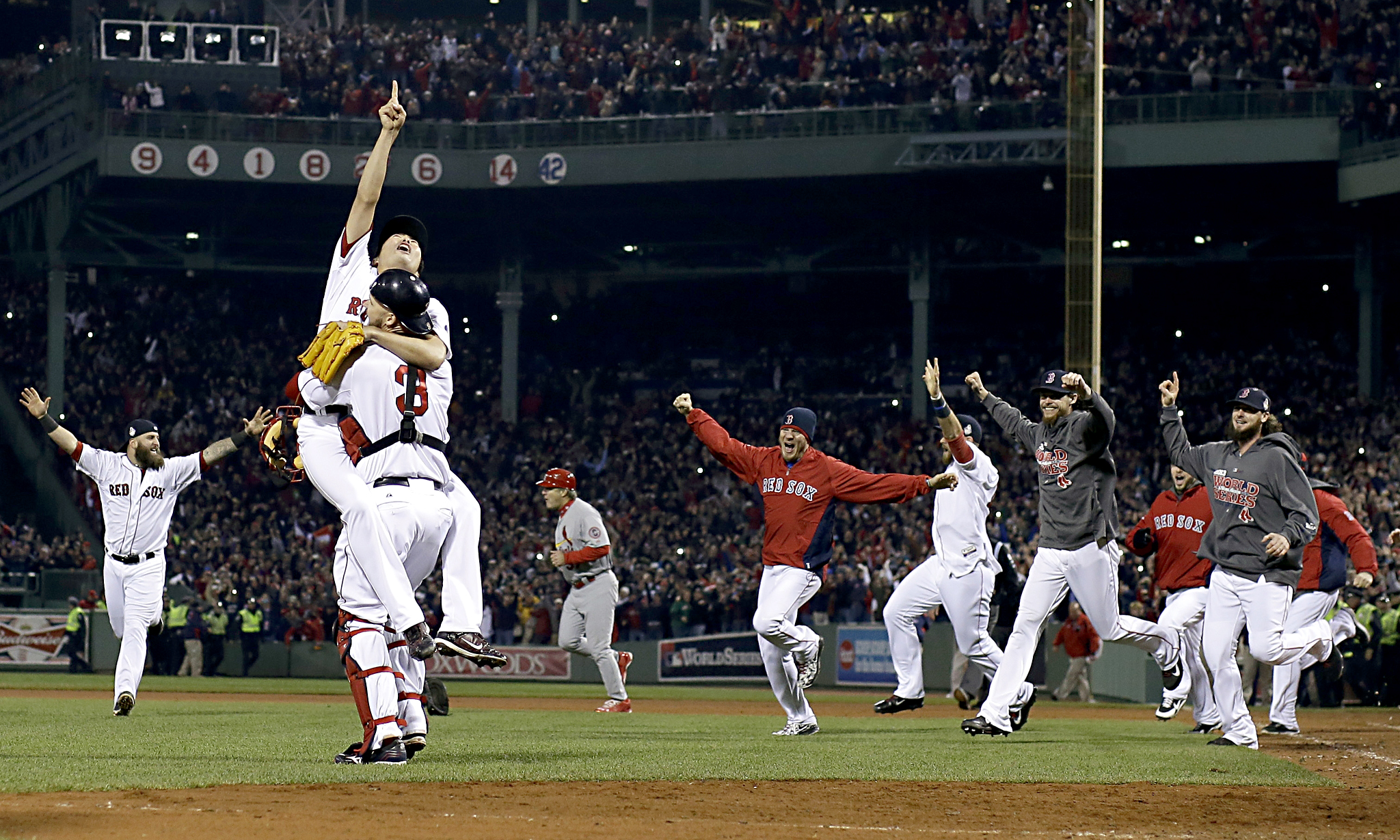 Boston Red Sox relief pitcher Koji Uehara and catcher David Ross celebrate as Red Sox beat St. Louis Cardinals' to end a 95 year wait to clinch the World Series title at Fenway Park Stadium, Boston. The last time Red Sox won the World Series, all-time great Babe Ruth was one of their lead pitchers.