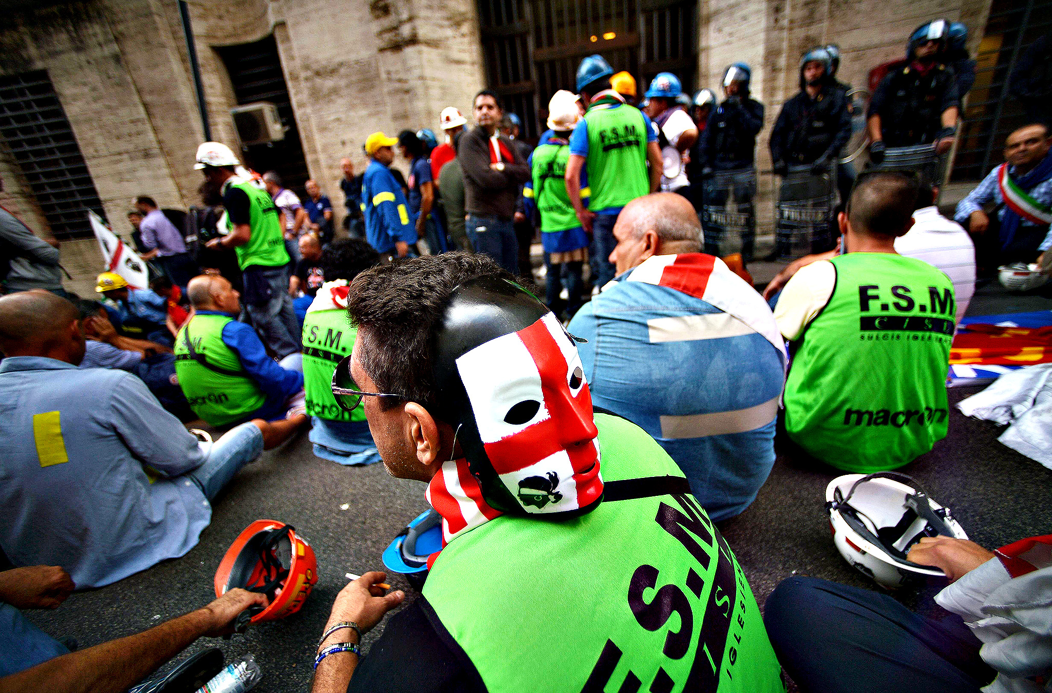Employees of American aluminum producer giant Alcoa take part in a sit-in outside the Italian Industry Ministry in Rome on Monday, as they demonstrate against the closing of the Portovesme and Fusina melting plants located on the Italian mediterranean island of Sardinia, which employ around 2,000 people.