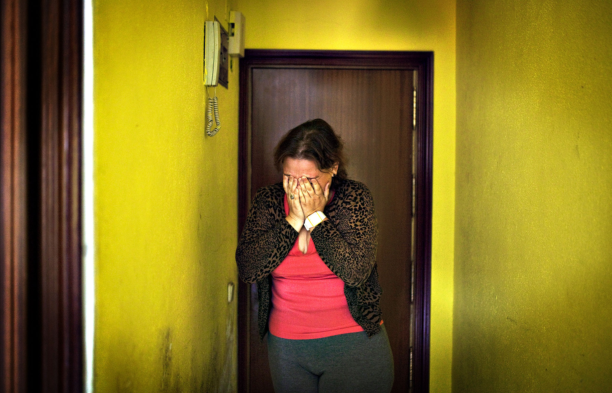Rocio de las Nieves Reyes Galvez, 28 years old, gestures as she waits to get evicted in Madrid, Spain, Wednesday. Reyes Galvez moved into a room of a foreclosed apartment owned by her friend with her 6-year-old daughter six months ago making small payments as she could afford. The landlord's loss of the apartment to Bankia bank is causing Reyes Galvez's eviction. Reyes Galvez has a disability produced by heart problems that prevents her from having a formal job. Three months ago she received her last pay-check, a state benefit payment of 426 euros. The eviction was finally postponed till Nov. 15 with the help of the Victims' Mortgage Platform (PAH).