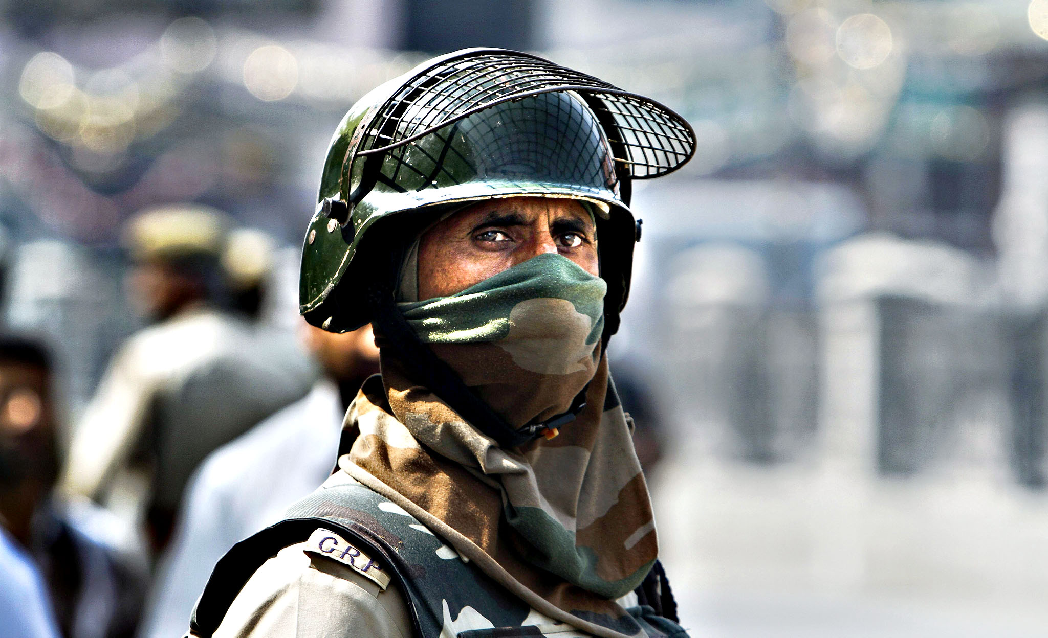 An Indian paramilitary soldier stands guard during a surprise search operation in the business hub of Lal Chowk in Srinagar, the summer capital of Indian Kashmir, 07 October 2013 Indian Army officiating Brigadier General Staff, Sanjay Mitra said a major infiltration bid by militants is underway in the Keran sector along the Line of Control, the de facto border which divides Kashmir into Indian and Pakistan administered parts.