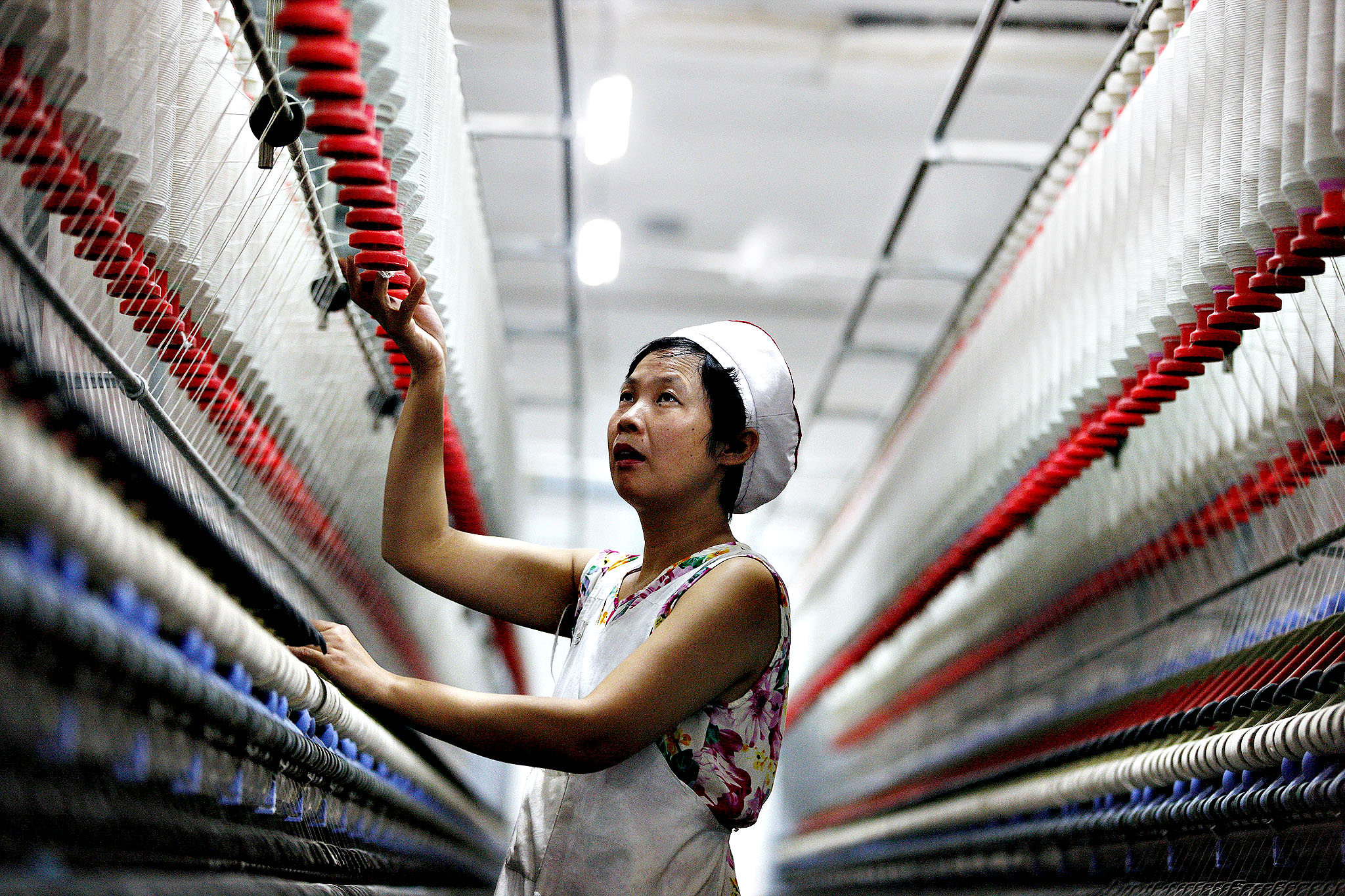 An employee works in a textile factory in Huaibei, east China's Anhui province on Thursday. China's manufacturing activity expanded at its strongest pace in seven months in October, British banking giant HSBC said, adding to evidence the world's second-largest economy is recovering.