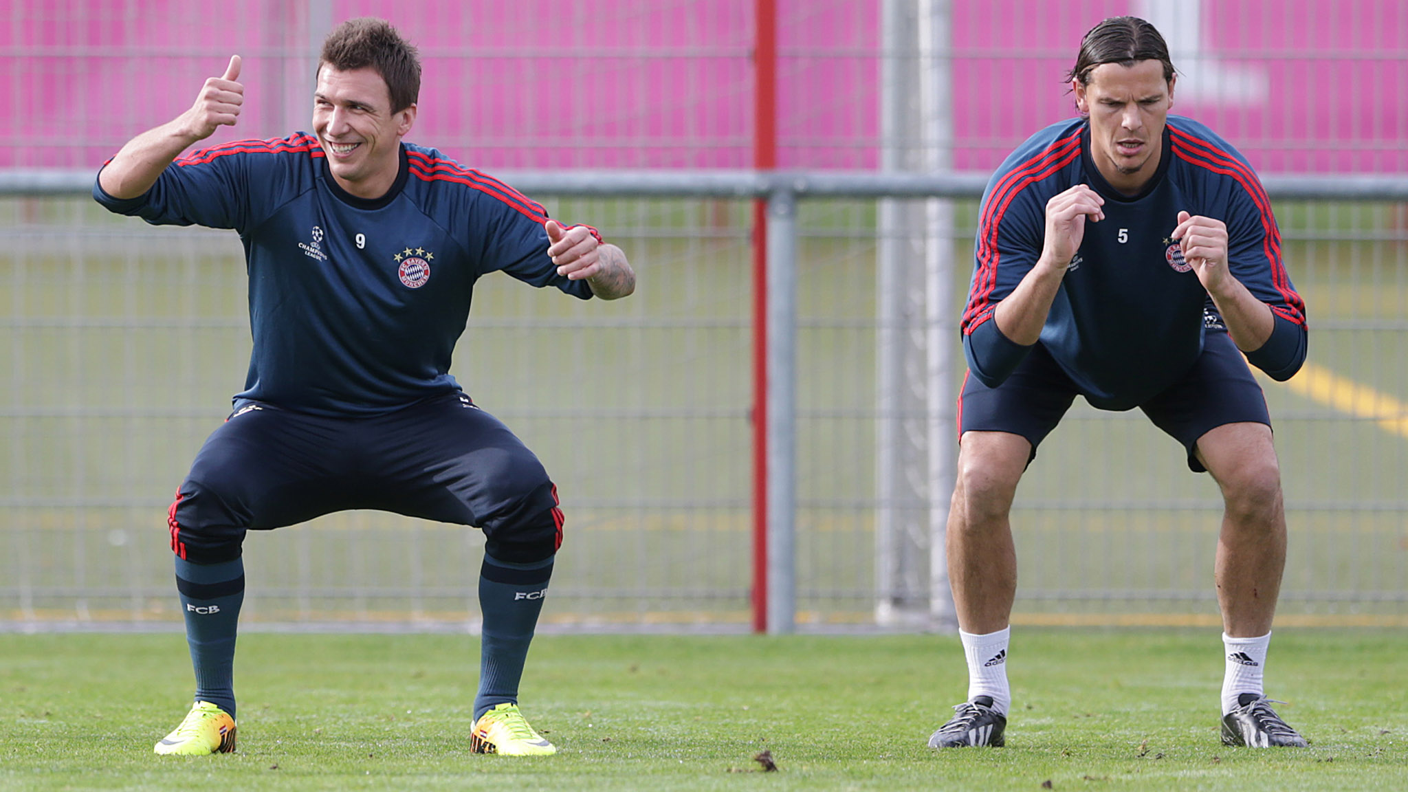 Mario Mandzukic, Daniel van Buyten...Bayern's Mario Mandzukic of Croatia, left, and teammate  Daniel van Buyten of Belgium stretch during a last training session prior to the Champions League group D soccer match between FC Bayern Munich and Viktoria Plzen, in Munich, southern Germany, Tuesday, Oct. 22, 2013. Munich will face Plzen Wednesday. (AP Photo/Matthias Schrader)