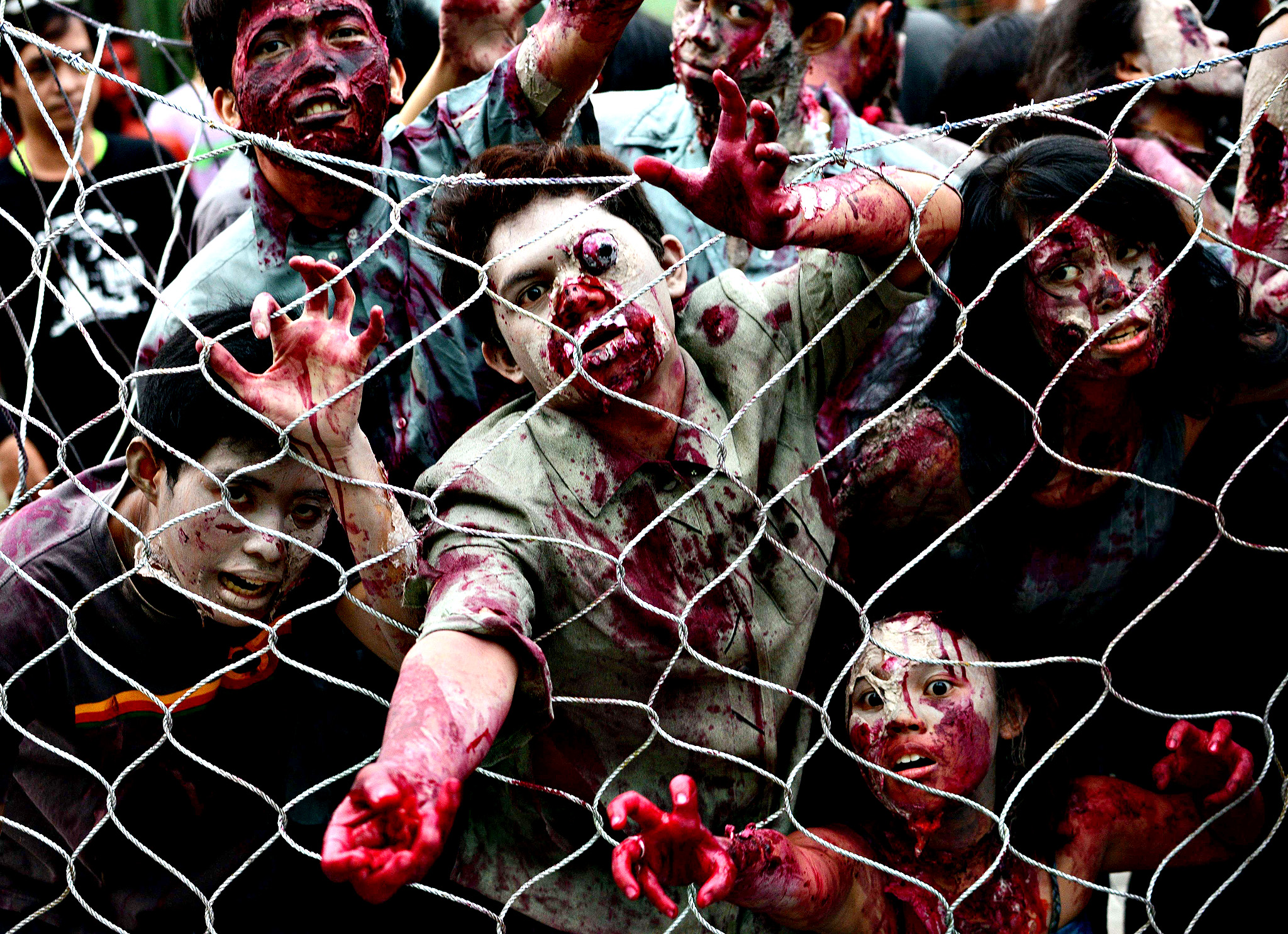 Students dressed as zombies participate in an annual Halloween Costume Parade in Manila on October 30, 2013. The activity aims to celebrate Halloween in a creative and fun way through showcase of different scary costumes.