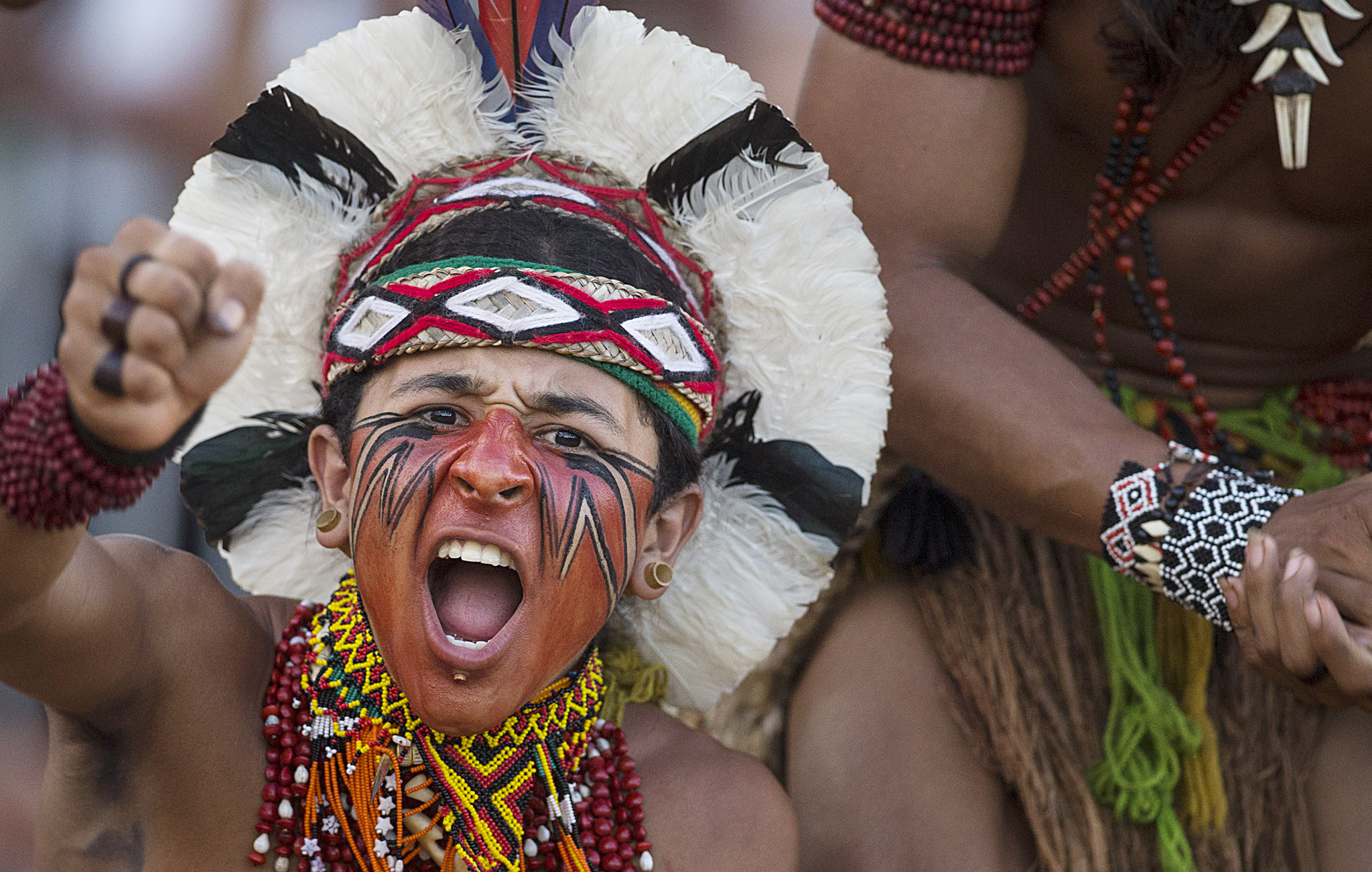 "A Pataxo Indian celebrates after his tribe defeated their competitors in a tug of war competition during the 12th Indigenous Games in Cuiaba, Brazil, Thursday, Nov. 14, 2013. More than 1,500 participants from 48 Brazilian tribes, as well as from more than a dozen other nations, descended this week on Cuiaba, the capital of Mato Grosso state, for the games that end Saturday. All participants will earn ""medals"" carved from wood, seeds and other natural items."