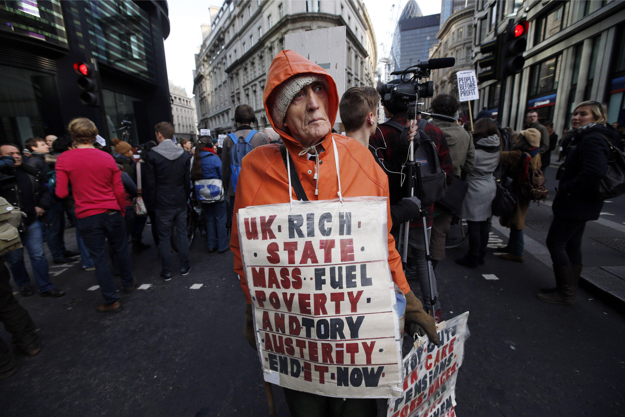 A protester, name not given, demonstrates against rising energy prices outside the headquarters of energy provider Npower in London's City financial district, Tuesday, Nov. 26, 2013. Hundreds of people from protest groups including UK Uncut and Fuel Poverty Action demonstrated against the rising energy prices.
