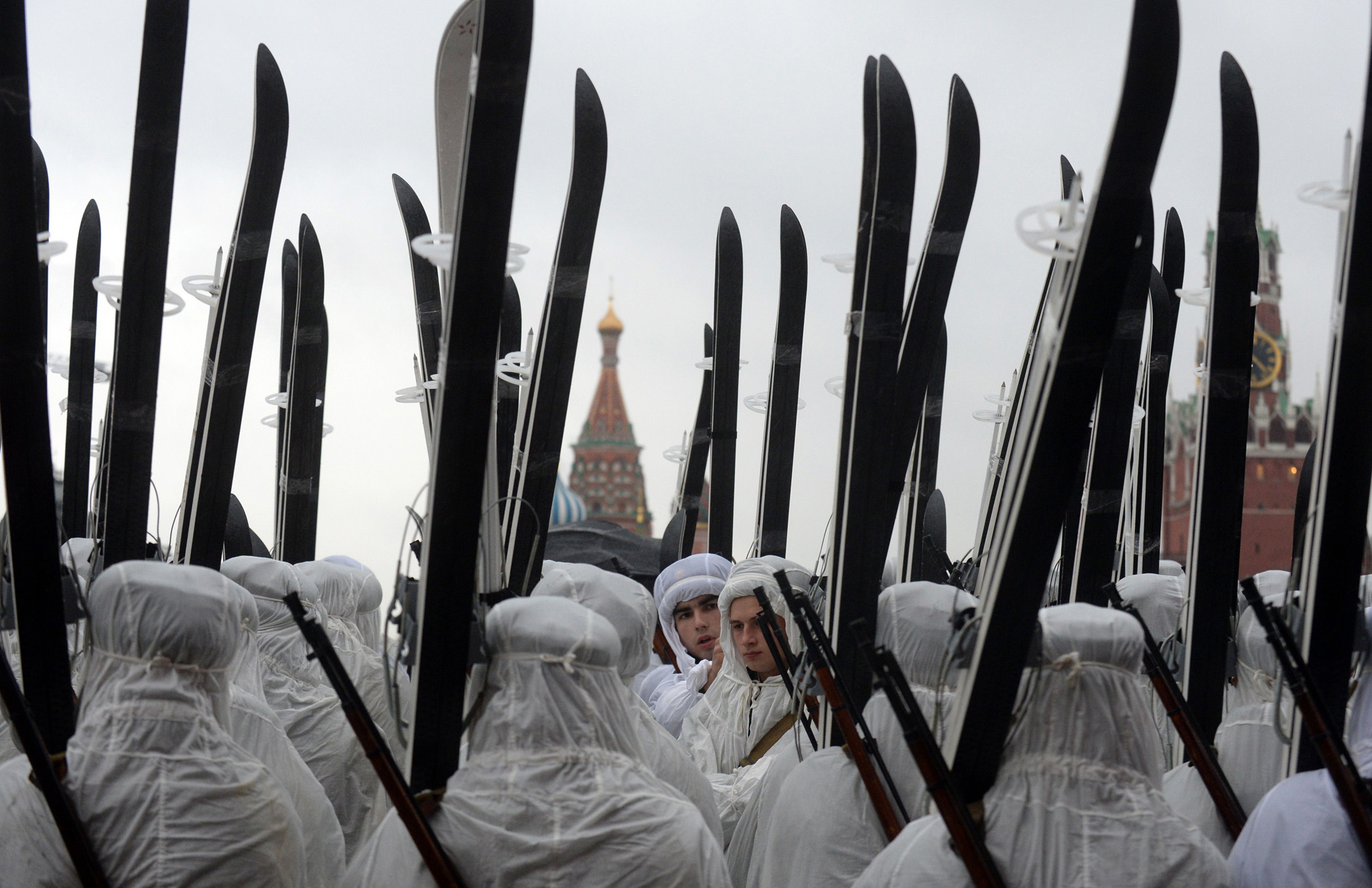 Russian soldiers wearing WWII-era white winter camouflage smocks, holding skis and carrying Mosin rifles stand at Red Square in Moscow, during a rehearsal of the upcoming military parade marking the 72nd anniversary of the November 7, 1941, parade, when Red Army troops marched past the Kremlin and then went directly to the front line to fight the German army which was at the gates of the Russian capital.