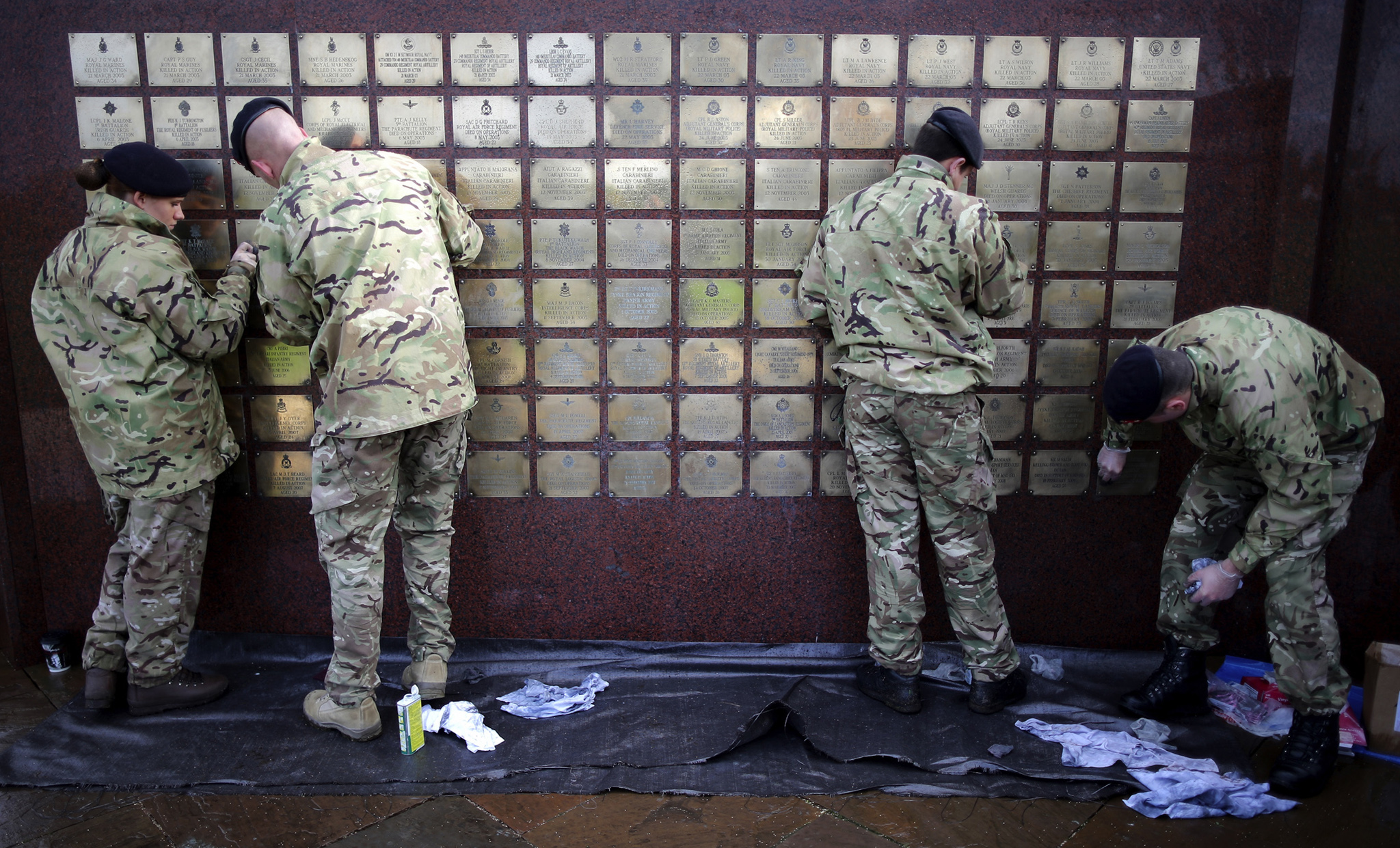Soldiers of 256 Squadron of The Royal Signals clean and prepare The Basra Wall ahead of Armistice Day at The National Memorial Arboretum in Alrewas, Staffordshire.