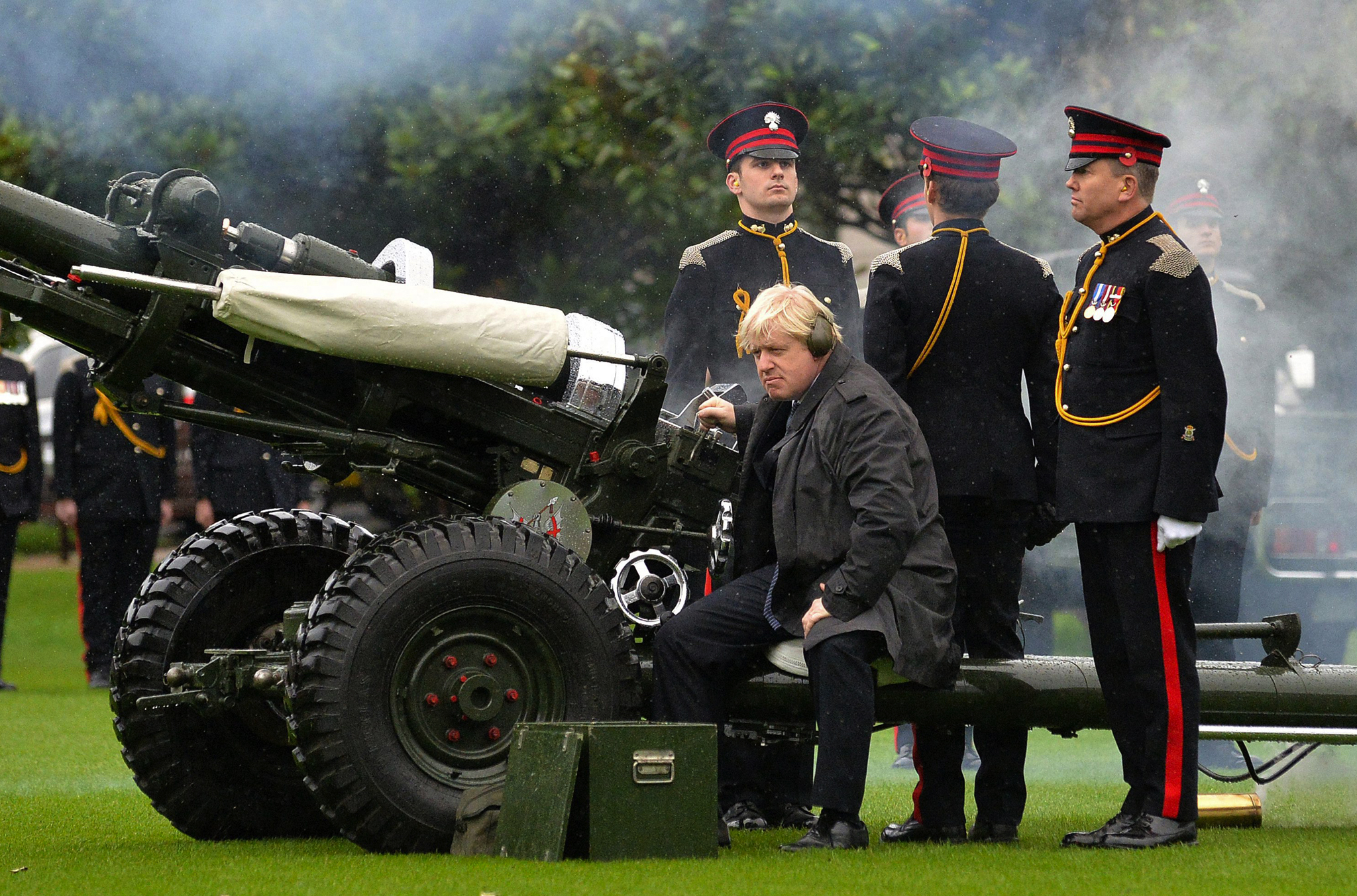 Mayor of London, Boris Johnson firing the salute from the Honourable Artillery Company's 105mm light gun to mark the launch of London Poppy Day at Armoury House, home of the Honourable Artillery Company (HAC), London.,