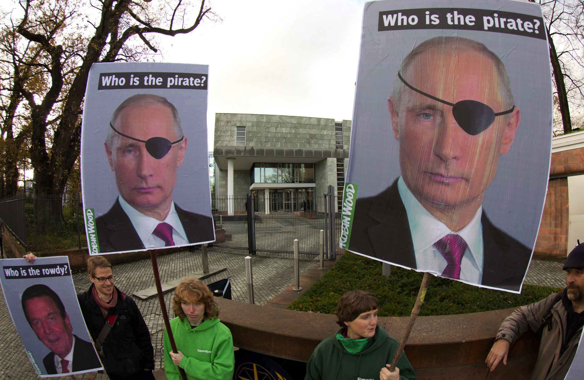 Activists of the environmental organization Robin Wood hold placards depicting Russia's President Vladimir Putin and former German Chancellor Gerhard Schroeder (L) as they demonstrate in front of the International Tribunal for the Law of the Sea in Hamburg. The Tribunal was holding a hearing into the dispute between the Netherlands and Russia over the seizure by Russian forces of a Dutch-flagged Greenpeace vessel 'Arctic Sunrise'.