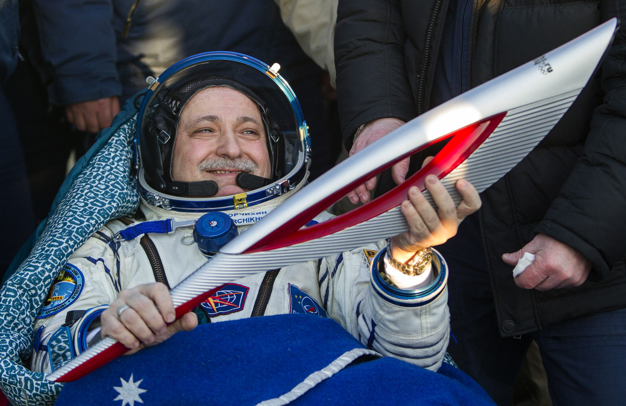 The International Space Station (ISS) crew member Russian cosmonaut Fyodor Yurchikhin holds the torch of the 2014 Sochi Winter Olympic Games after landing near the town of Zhezkazgan in central Kazakhstan. Three astronauts returned to Earth, after 66 days aboard the International Space Station, bringing the Olympic torch back after a historic space walk.