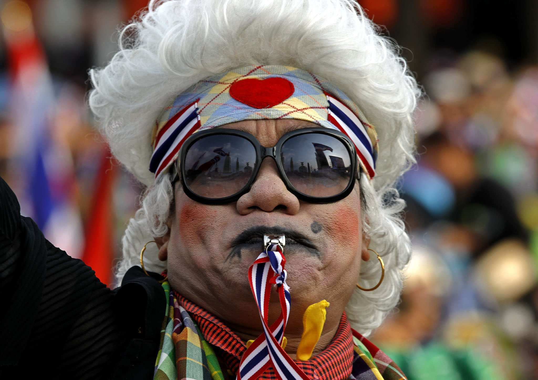 A Thai anti-government protester blows a whistle as she participates in a protest at the Democracy Monument in Bangkok, Thailand. Thai Prime Minister, Yingluck Shinawatra, called for an end to protests against a bill that would provide amnesty for political crimes after the lower house of parliament cancelled further legislation on the issue.