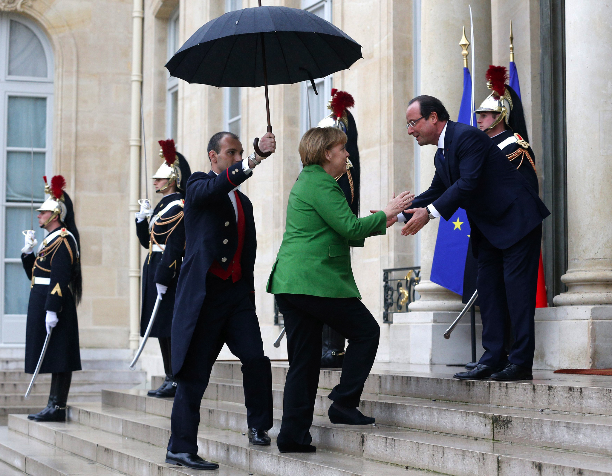 French President Francois Hollande greets German Chancellor Angela Merkel upon her arrival at the Elysee Palace, in Paris. European leaders are to discuss the continent's youth unemployment crisis amid concerns that the despair of nearly 6 million jobless is feeding into mounting social tensions and populism.