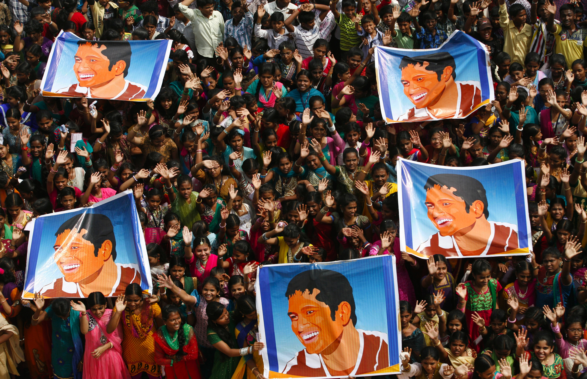 Indian school children display posters of Indian cricket star Sachin Tendulkar as they gather to honor him in Chennai, India. Tendulkar plays his world-record 200th and last test from Thursday in a hometown stadium for which tickets could have been sold 10 times over.