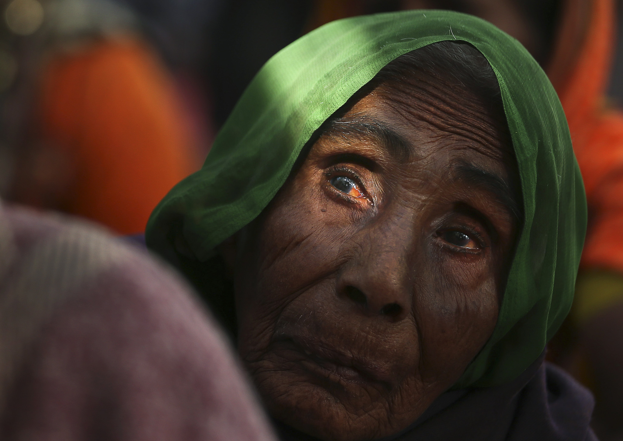 An elderly woman participates in a protest in New Delhi, India, Wednesday, Nov. 27, 2013. The protesters demanded a universal old age pension for those above 60 years of age,  opposing the central governmentís proposal of US$ 3 per month. India is home to 142.9 million elderly, aged above 54 years. (AP Photo/Manish Swarup)