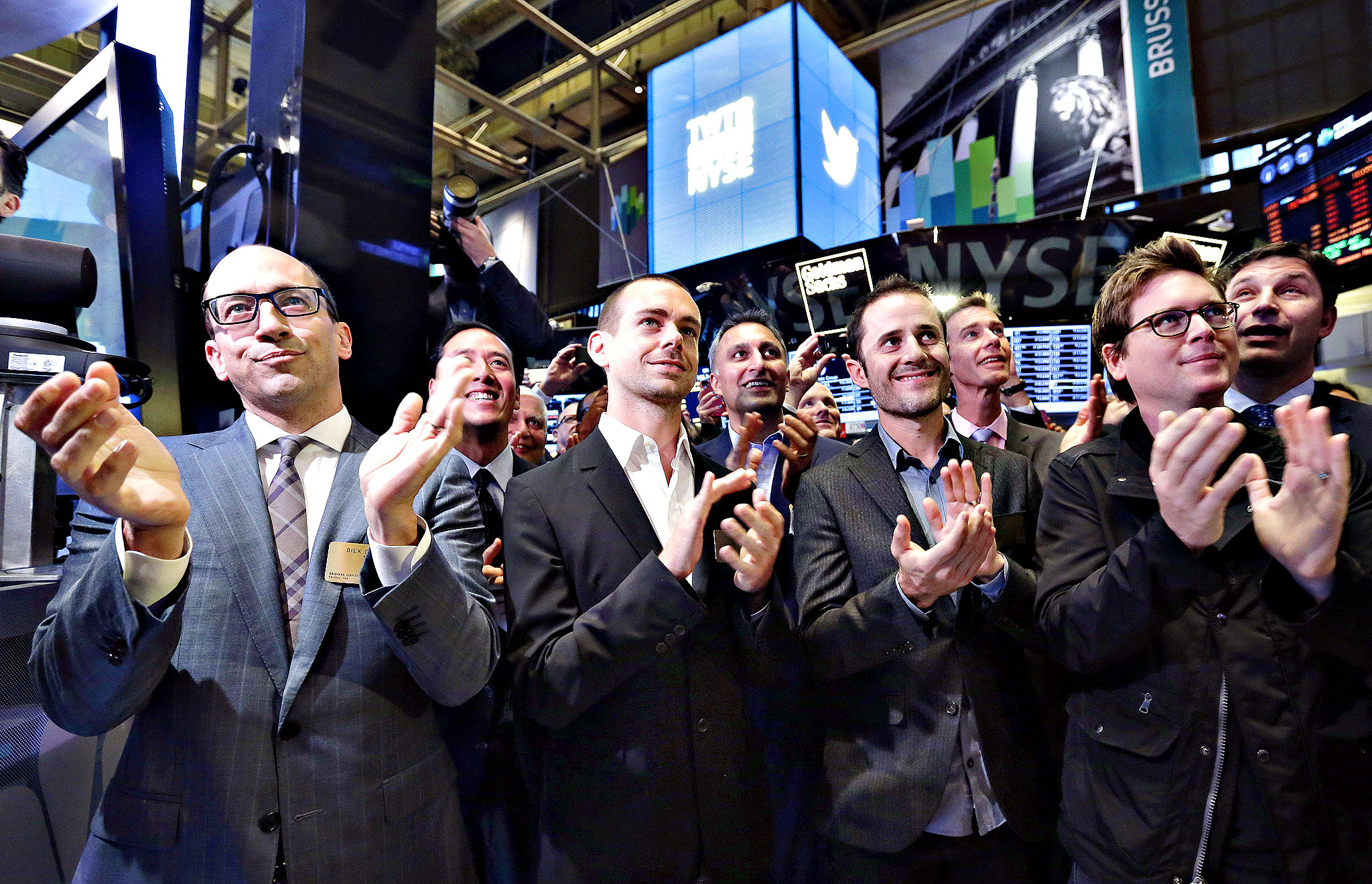 Dick Costolo, Jack Dorsey, Evan Williams, Biz Stone...Twitter CEO Dick Costolo, Chairman and co-founder Jack Dorsey, and co-founders Evan Williams and Biz Stone, front row left to right, applaud as they watch the the New York Stock Exchange opening bell rung, Thursday, Nov. 7, 2013.  If Twitter's bankers and executives were hoping for a surge on the day of the stock's public debut, they got it. The stock opened at $45.10 a share on its first day of trading, 73 percent above its initial offering price.