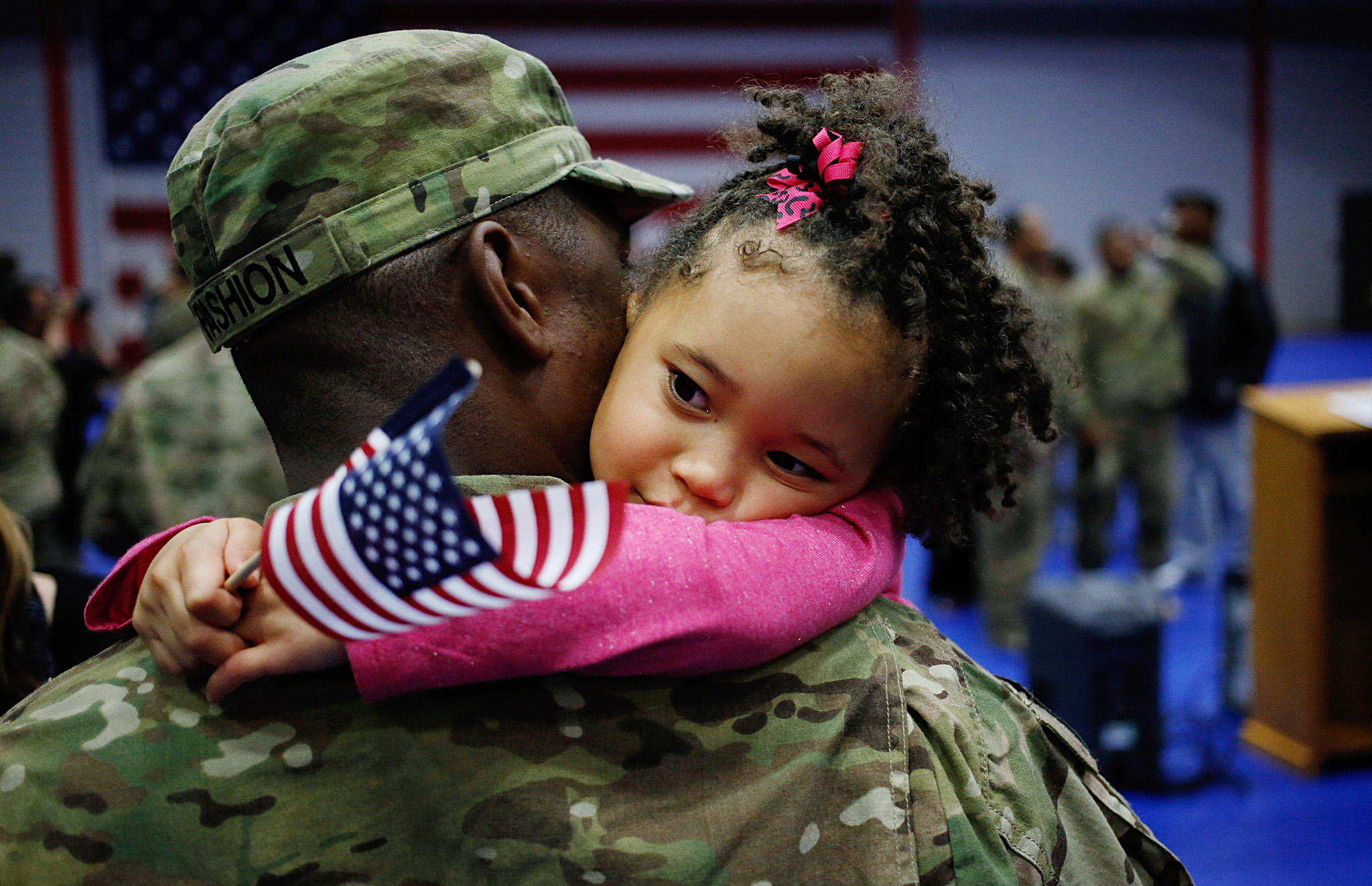 Soliders From Army's 3rd Brigade Return Home From Afghanistan To Fort Knox...FORT KNOX, KY - NOVEMBER 20: Spc. Michael Fashion of the U.S. Army's 3rd Brigade Combat Team, 1st Infantry Division, holds his daughter Malia Banks, 5, following a homecoming ceremony in the Natcher Physical Fitness Center on Fort Knox in the early morning hours of Wednesday, November 20, 2013 in Fort Knox, Ky. The 250 soldiers returned to Fort Knox after a nine-month combat deployment working alongside Afghan military and police forces in Afghanistan's Zabul Province.