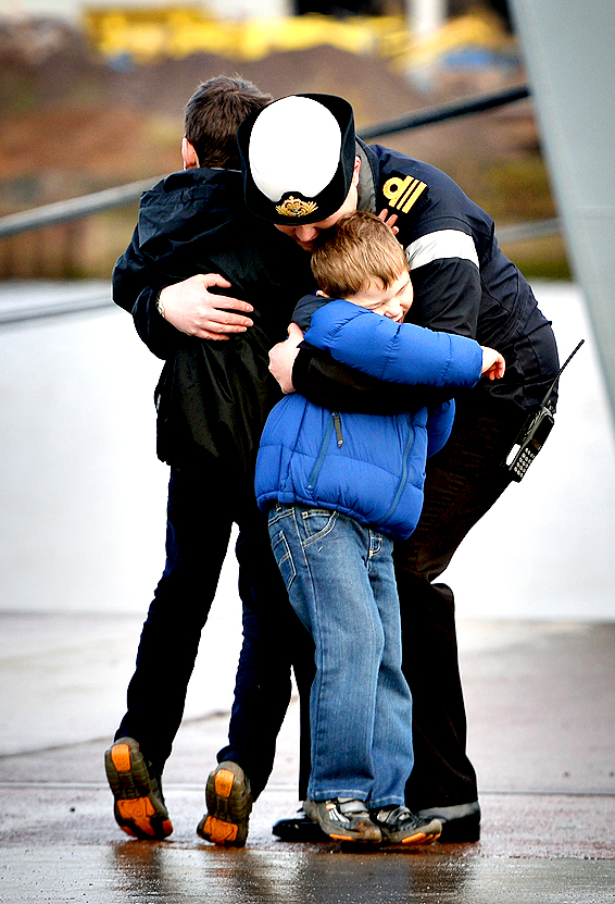 Lieutenant Commander Kirsty Flegg hugs her two sons Jack, aged 6, and Toby, aged 4, following a deployment on HMS Defender on Friday in Glasgow, Scotland. HMS Defender is one of the Royal Navy's new Type 45 destroyers, and has returned to Glasgow where it was built for the first time since becoming a fully fledged member of the fleet and will be open to the public tomorrow.