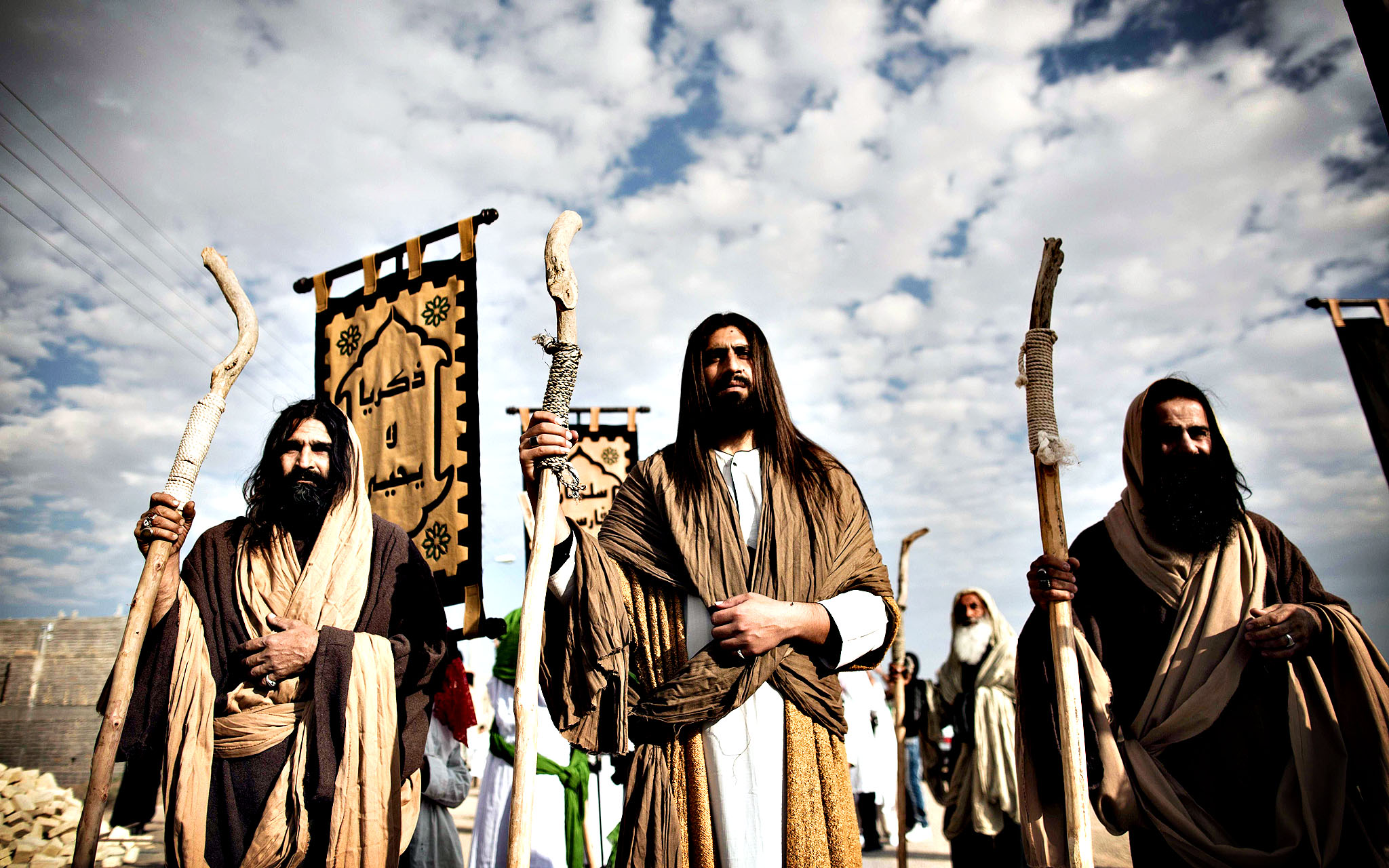 "An Iranian Muslim Shia man, acting as the prophet Jesus (C) and his apostles before the battle of Karbala, take part in the annual religious performance of ""Taazieh"" in the Iranian town of Noosh Abad near the central city of Kashan on November 12, 2013, marking the mourning period of Ashura which commemorates the killing of Prophet Mohammed's grandson Imam Hussein."