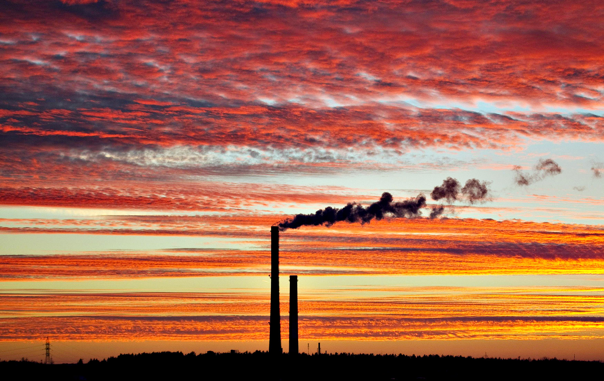 Smoke rises from the chimney stalk of a gas-fired power station after sunset on the outskirts of Minsk, November 18, 2013.