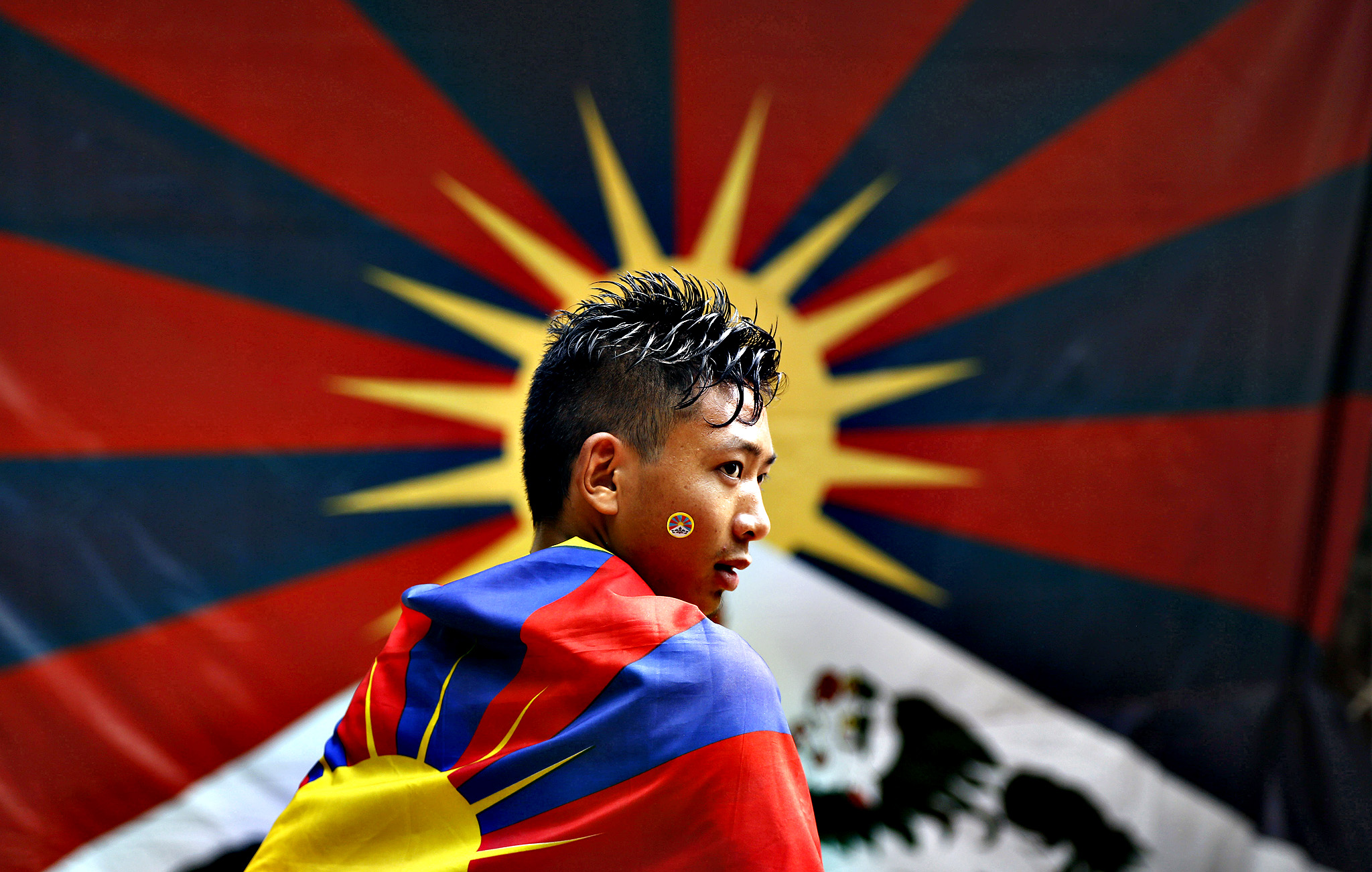 A Tibetan exile wears a Tibetan flag and participates in a protest rally in New Delhi, India, Wednesday, Nov. 6, 2013. The rally was held to seek the attention of the international community towards the plight of Tibetans in Tibet and for the release of Tibetan political prisoners in China, among others, according to a press release.
