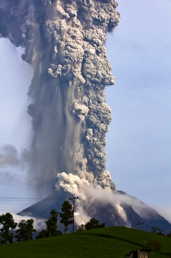 ***BESTPIX*** Mount Sinabung Erupts Again In Indonesia...MEDAN, SOUTH SUMATRA, INDONESIA - NOVEMBER 14:  Mount Sinabung spews pyroclastic smoke as seen from Tigapancur village in Karo district on November 14, 2013 in Medan, Sumatra, Indonesia. Up to 4,300 residents have been evacuated from five villages in North Sumatra due to the volcanic eruptions of Mount Sinabung. The volcano has been erupting for several days, spewing ash and lava 2.5 miles into the sky.