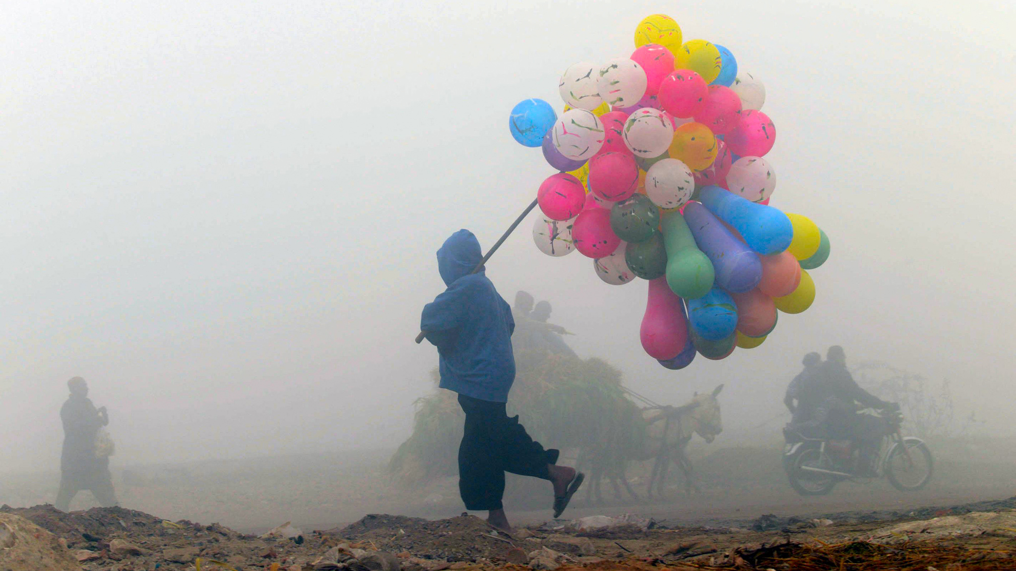 A Pakistani balloon vendor walks through...A Pakistani balloon vendor walks through a cold and foggy morning in Lahore on December 17, 2013. Ongoing foggy weather in Punjab and other parts of the country has badly affected flight and rail schedules. TOPSHOTS  AFP PHOTO/ARIF ALIArif Ali/AFP/Getty Images