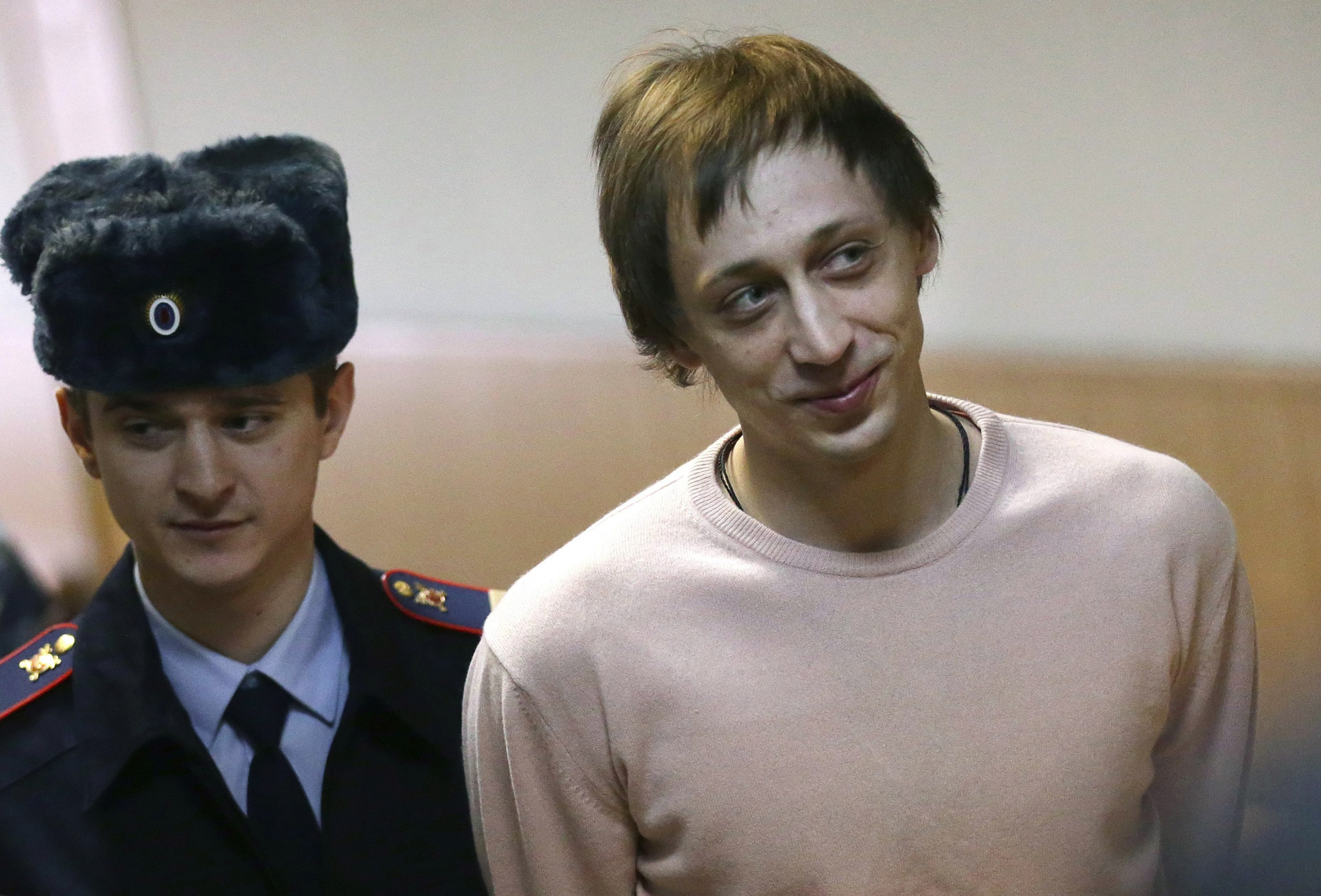 Former Bolshoi ballet dancer Pavel Dmitrichenko is escorted by policemen for sentencing at Meshansky district court in Moscow, Russia. Bolshoi dancer Pavel Dmitrichenko was found guilty of masterminding an acid attack on the world-renowned Moscow theatre's artistic director Sergei Filin on 17 January 2012. The attack left Filin with severe burns and nearly blinded.