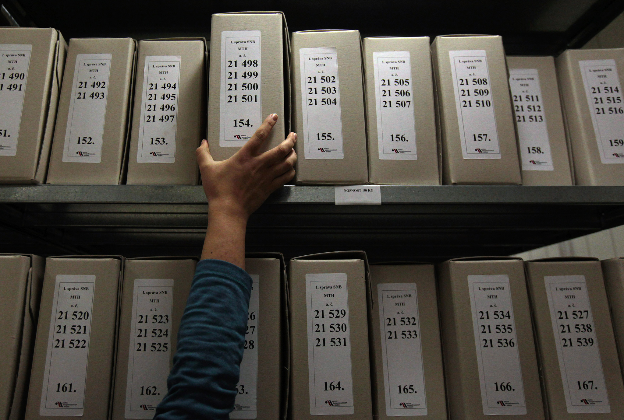 A worker of Security Services Archive searches files in The Institute for the Study of Totalitarian Regimes in Prague. When Czechs threw off Communism in 1989, they adopted strict rules marginalising anyone with ties to the repressive old regime. But now they are asking whether it's time to move on. The soul-searching has been stirred by Andrej Babis, a businessman-turned politician poised to join a new coalition government despite allegations - which he denies - of past collaboration with the Communist secret police.