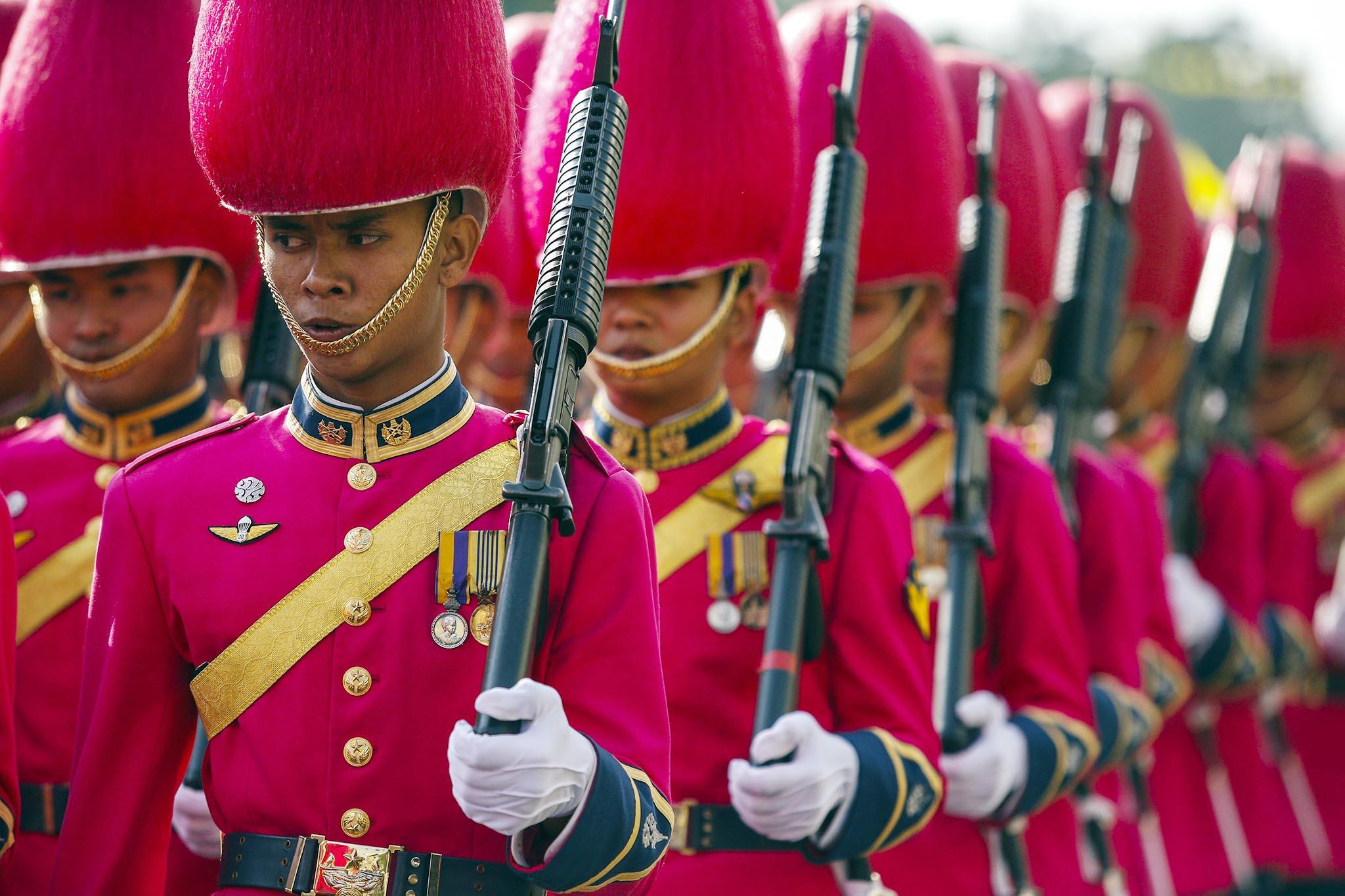 Thai royal guards of honour march during a parade to celebrate Thai King Bhumibol Adulyadej's 86th birthday at Klai Kangwon Palace, Hua Hin