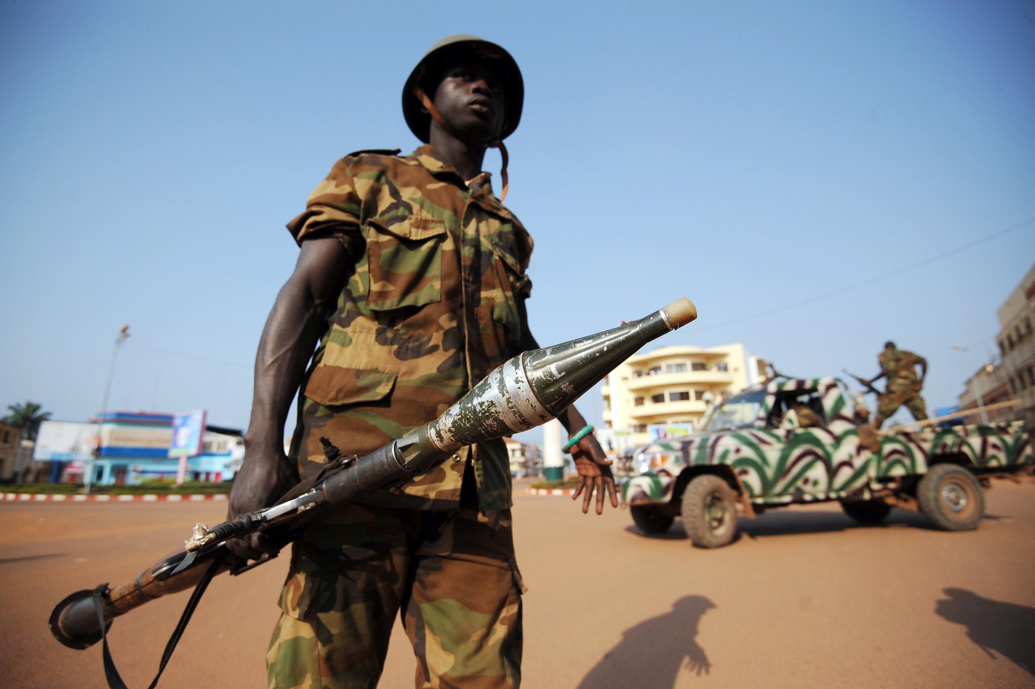 Soldiers patrol on December 5, 2013 in a street of Bangui