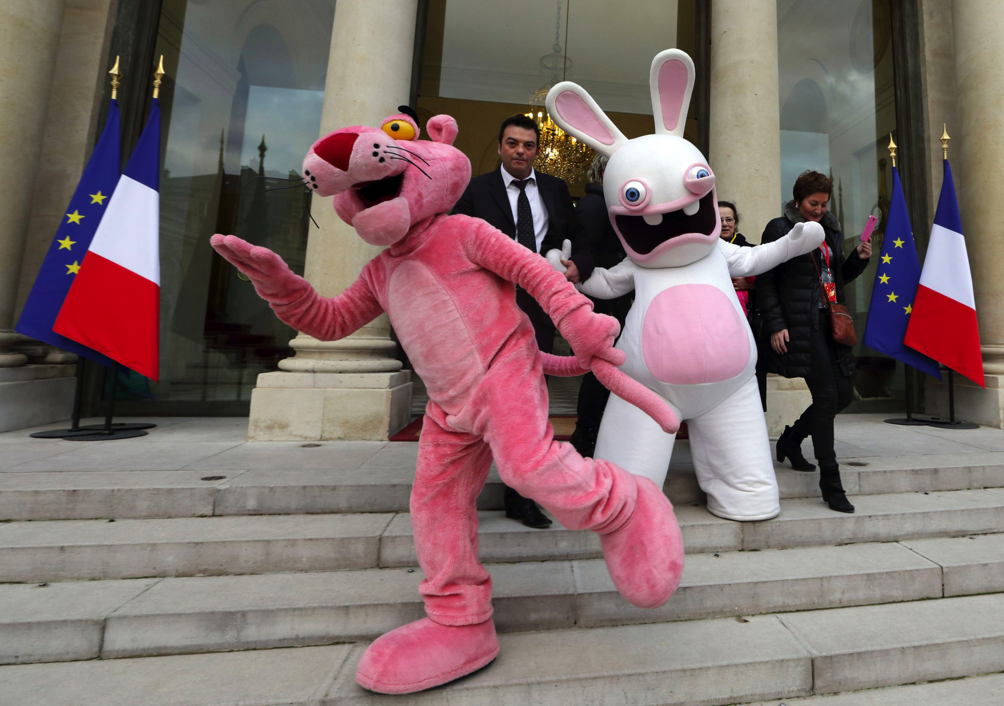 Life-size cartoon characters of the Pink Panther and Raving Rabbit (Lapin Cretin) pose on the stairs of the Elysee Palace at the end of the Elysee Palace Christmas party, in Paris.
