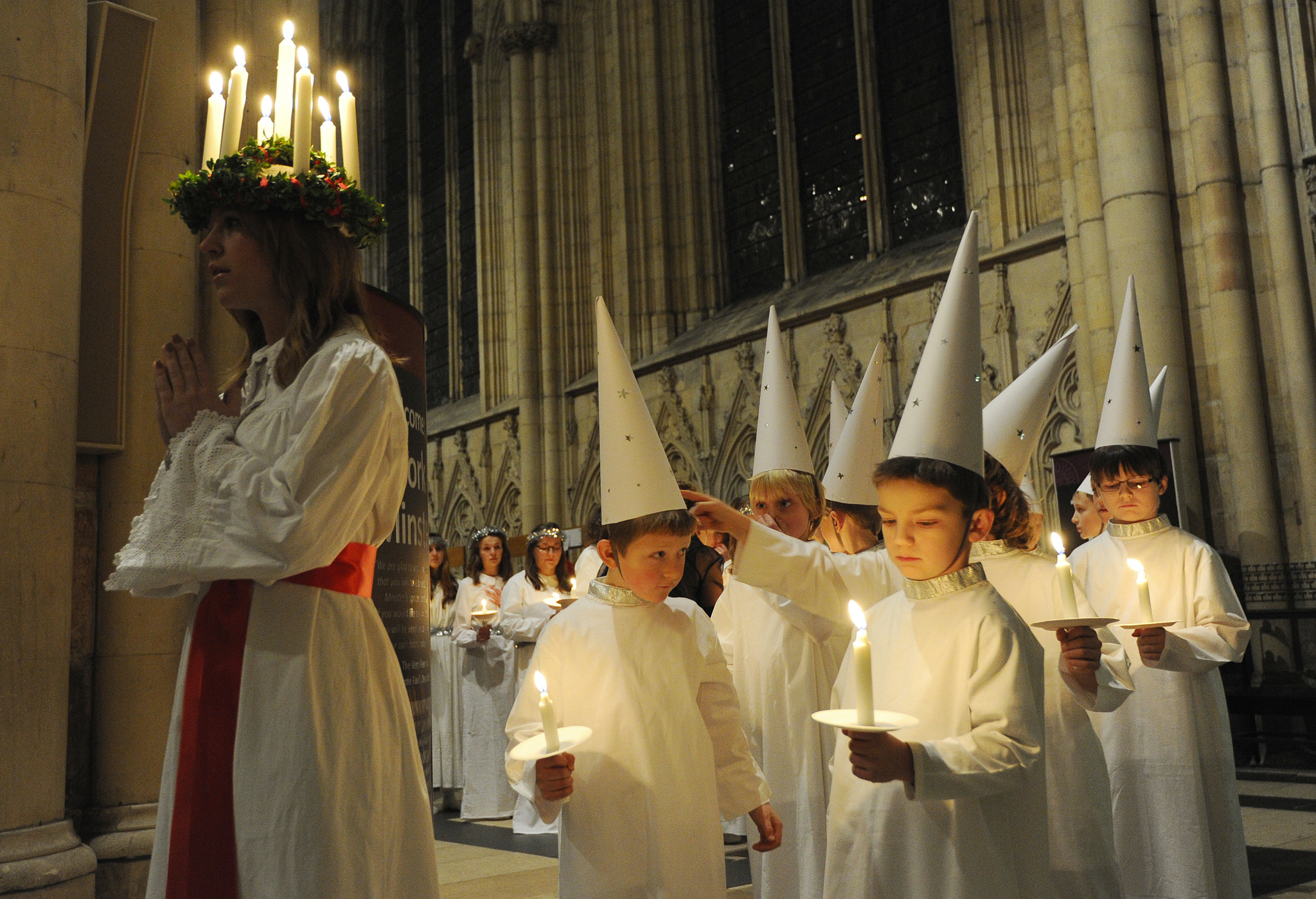 The Vaxholm Boys' Choir prepare to follow Sara Ringkrans at the start of the procession in the Nave of York Minster as part of the Sankta Lucia Festival.  The Sankta Lucia Festival of Light is an atmospheric, candlelit procession and carol service based on the Swedish Lucia celebration, a powerful symbol and celebration of light. This year it is the first time the service has been held at York Minster in partnership with York Anglo Scandinavian Society.