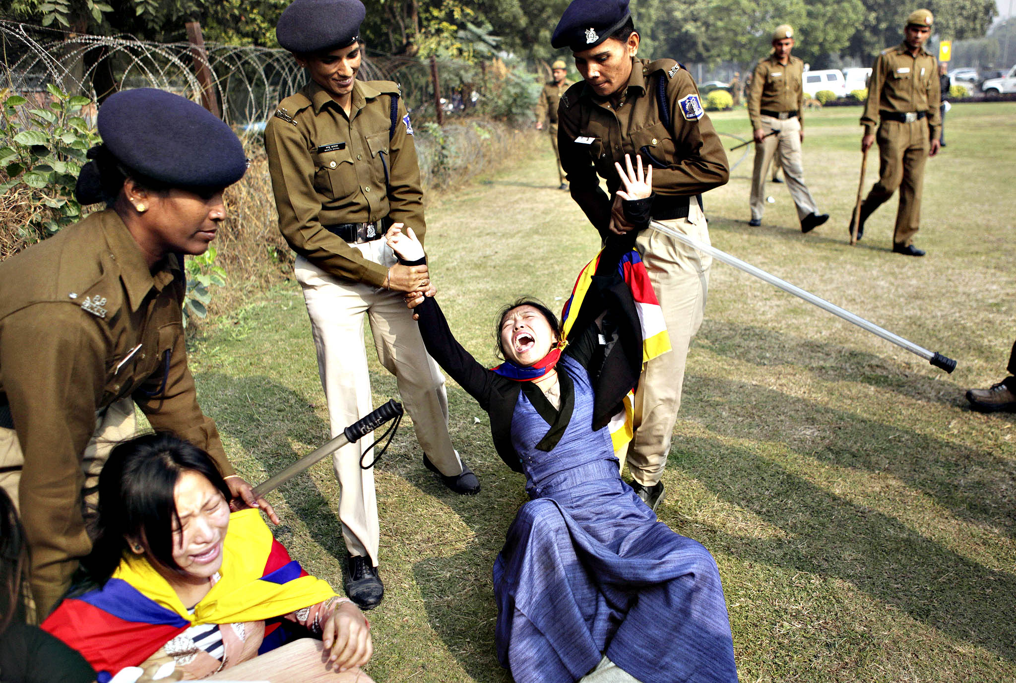 Tibetan exiles are taken in to detain by Indian policewomen during a protest against the alleged human rights abuses of Tibetans by the Chinese government outside the Chinese embassy on the eve of World Human Rights Day in New Delhi, India, Monday, Dec. 9, 2013. Tibetans also mark Dec. 10 as the Nobel peace Prize Day, the day their spiritual leader the Dalai Lama received the Nobel peace Prize in 1989.