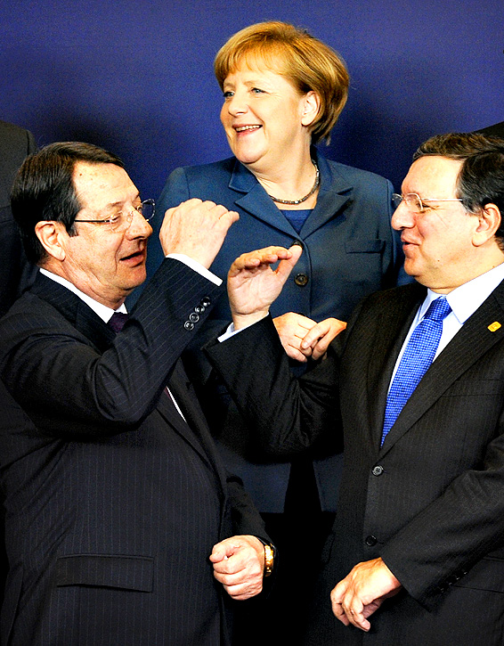 Cypriot President Nicos Anastasiades, German Chancellor Angela Merkel, and European Commission President Jose Manuel Barroso pose for a family picture during an EU summit focused on the common security, Defence policy and Economic and Monetary union, in Brussels on December 19, 2013. The European Union took a historic leap towards greater integration just hours ahead of a summit today, with a deal on a banking union to prevent a re-run of the eurozone's recent crisis.