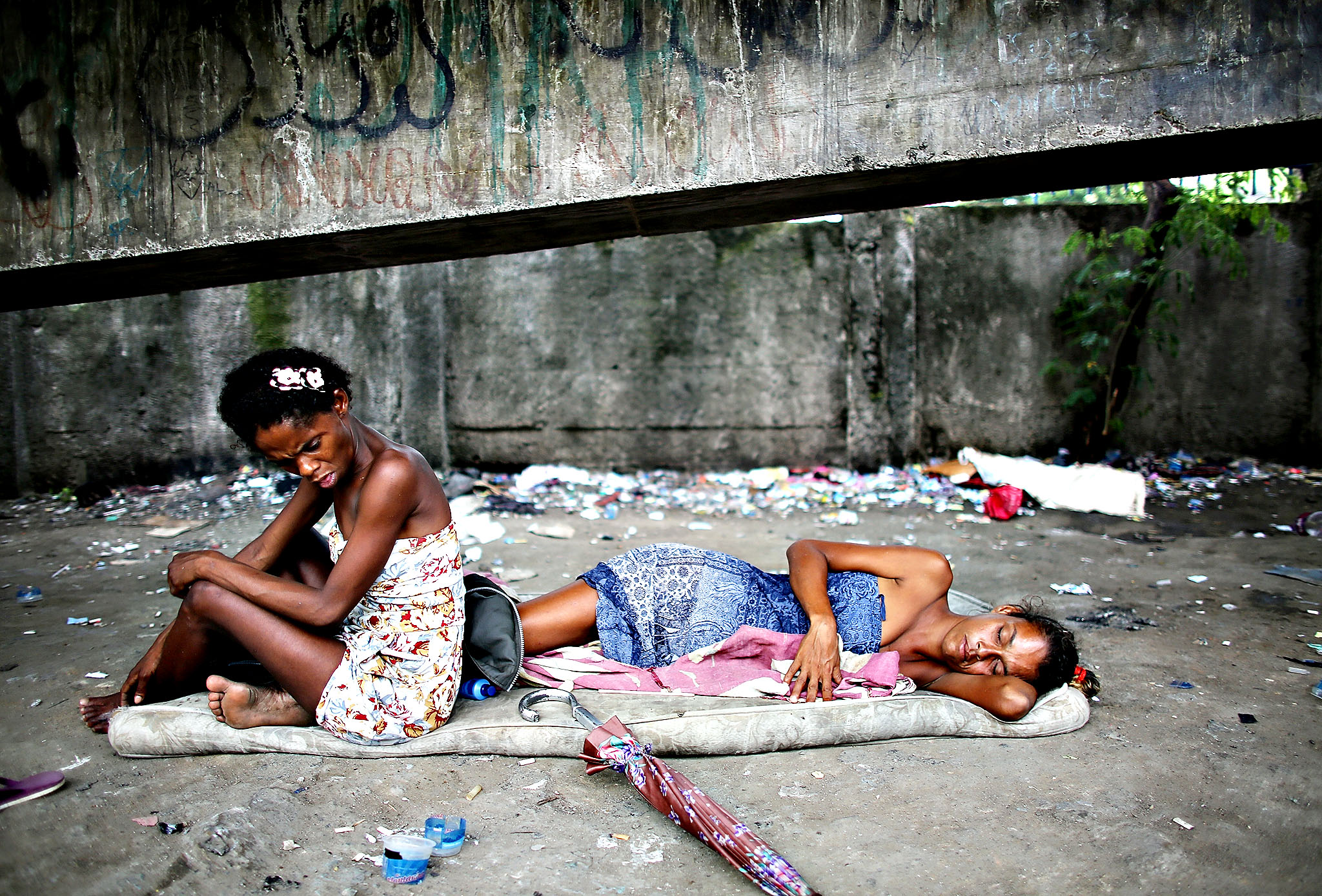 Drug users gather beneath an overpass in an area known as 'Cracolandia', or Crackland, in the Antares shantytown in Rio de Janeiro, Brazil. According to the Economist, recent studies have shown Brazil to be the world's largest crack market, with 1-1.2 million users.