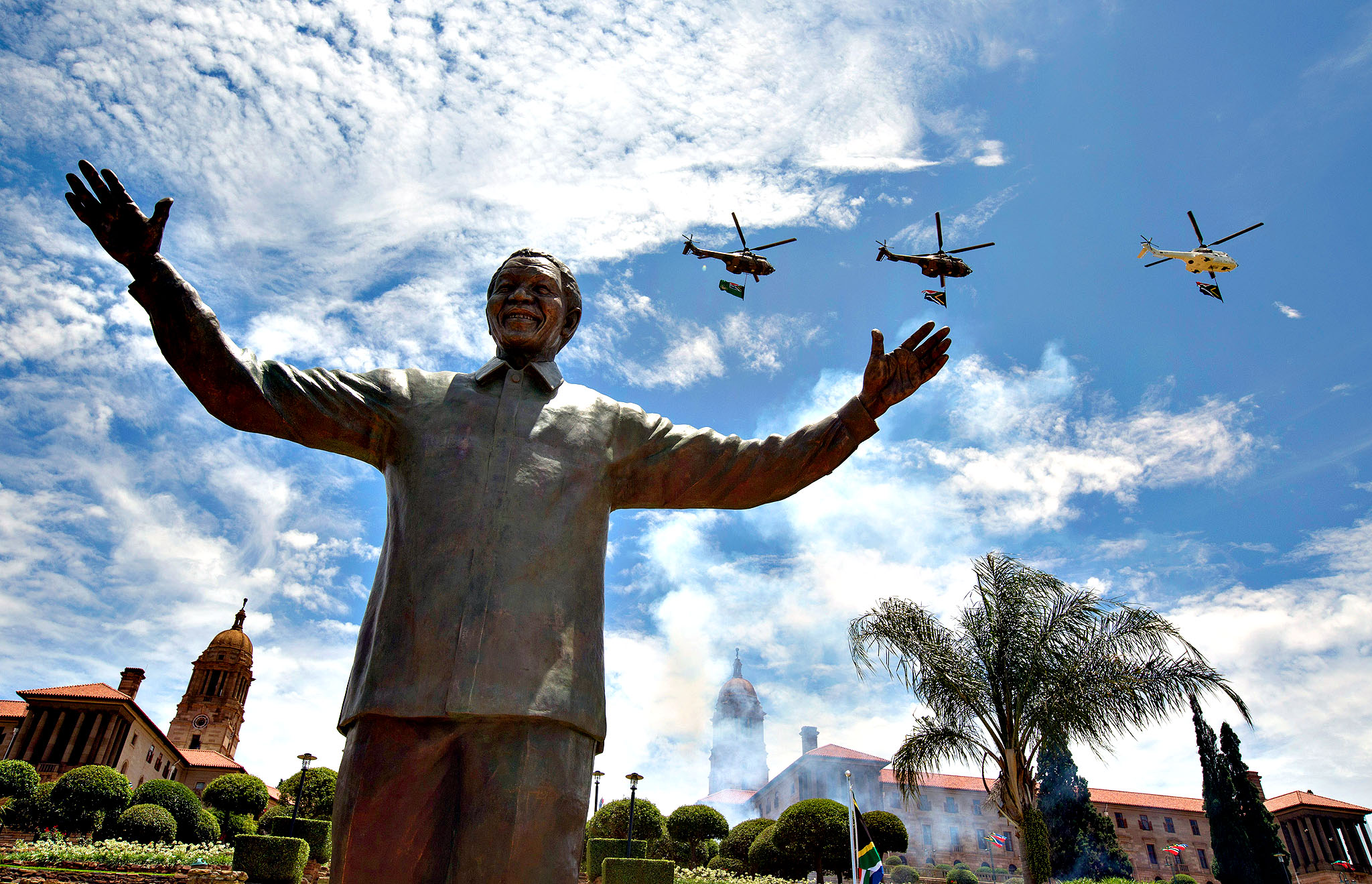 A military fly-past takes place above a statue of former South African president Nelson Mandela shortly after its unveiling at the Union Buildings on December 16, 2013 in Pretoria, South Africa.  South African president Jacob Zuma unveiled a 9 meter bronze statue of former South African president Nelson Mandela as part of the Day of Reconciliation celebrations.