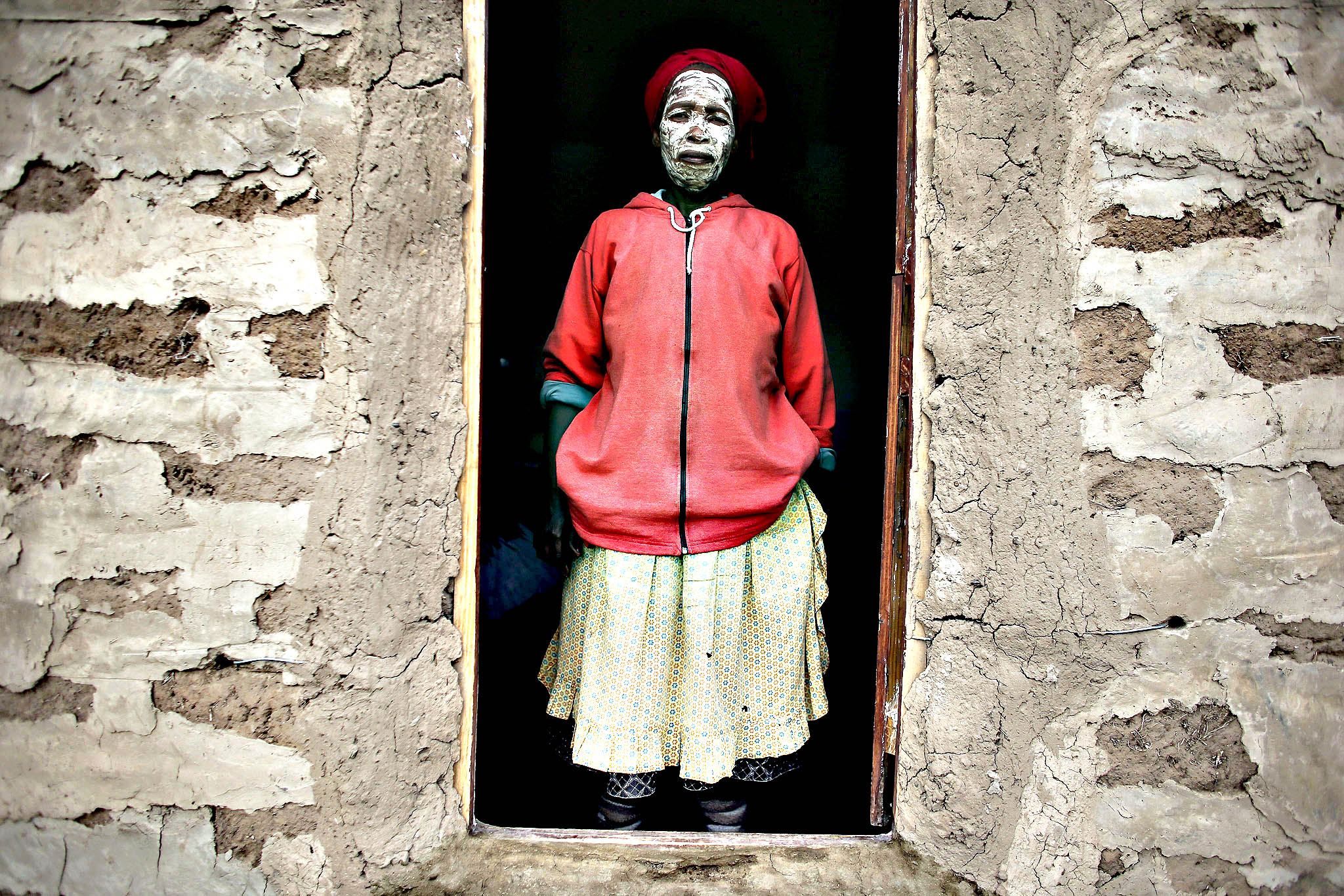 Sixty-two-year-old South African woman Olivia Tsangane, a neigbour of late South African president Nelson Mandela, poses for a photograph in Mandela's ancestral village of Qunu, South Africa, 09 December 2013. The former South African president and anti-Apartheid icon died after a long illness 05 December at the age of 95. He will be buried at his ancestral home in Qunu on 15 December 2013.