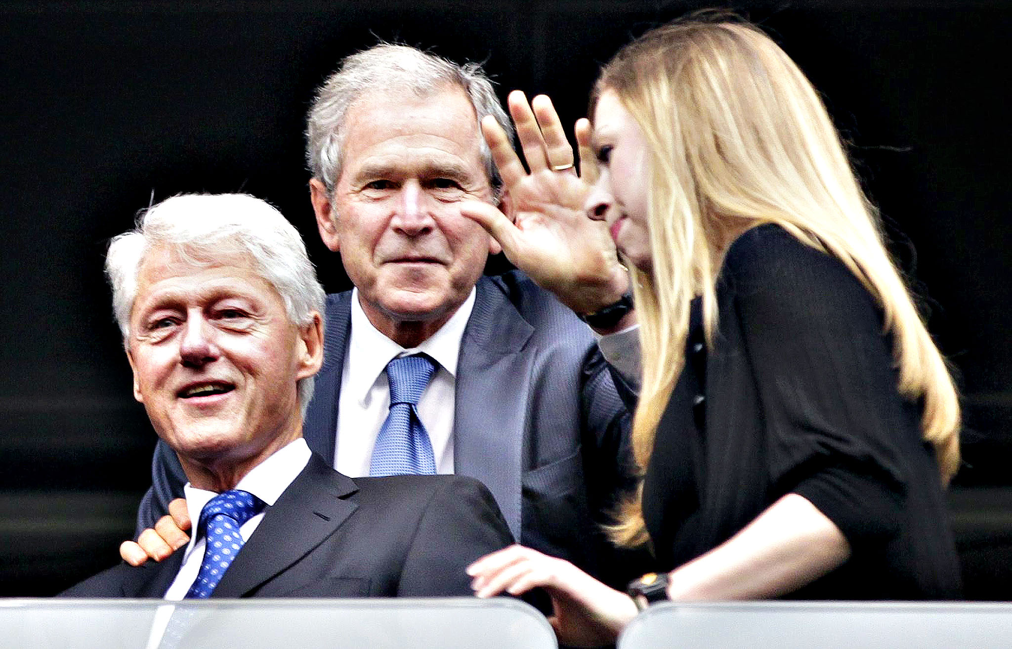 Former US presidents Bill Clinton (L), George W. Bush (C) and Clinton's daughter Chelsea Clinton (R) attend the official memorial ceremony for late South African president Nelson Mandela at FNB Stadium in Johannesburg, South Africa, 10 December 2013. Nobel Peace Prize winner Nelson Mandela died on 05 December at the age of 95.