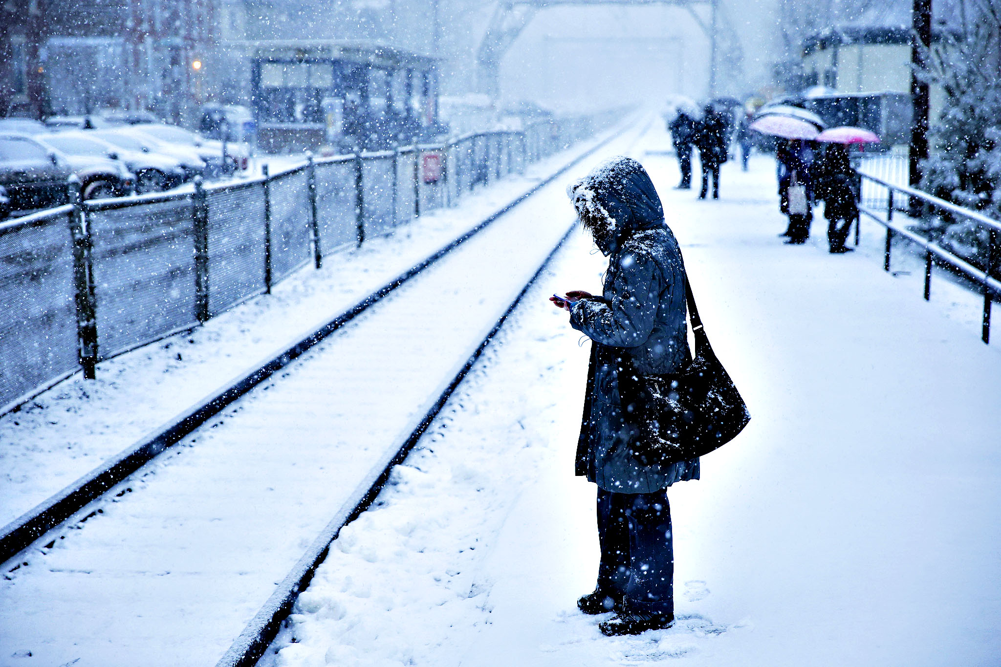 A commuter waits on a train during a winter snowstorm Tuesday, Dec. 10, 2013, in Philadelphia. Accumulations of 3 to 6 inches were expected as the National Weather Service issued a winter storm warning for the Eastern Seaboard, including Baltimore, Washington, D.C., Philadelphia and Wilmington