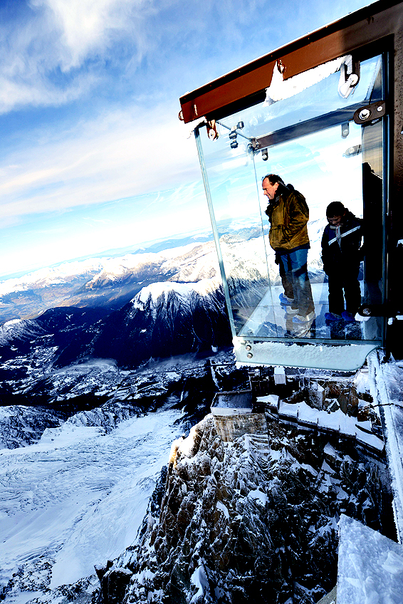 "People visit the ""Step into the Void"" glass skywalk overlooking the French Alps on top of a 3842-metre peak in Chamonix on December 23, 2013. The installation, which opened to the public after three years of development, is made of three layers of glass and can withstand winds of up to 200kmph."