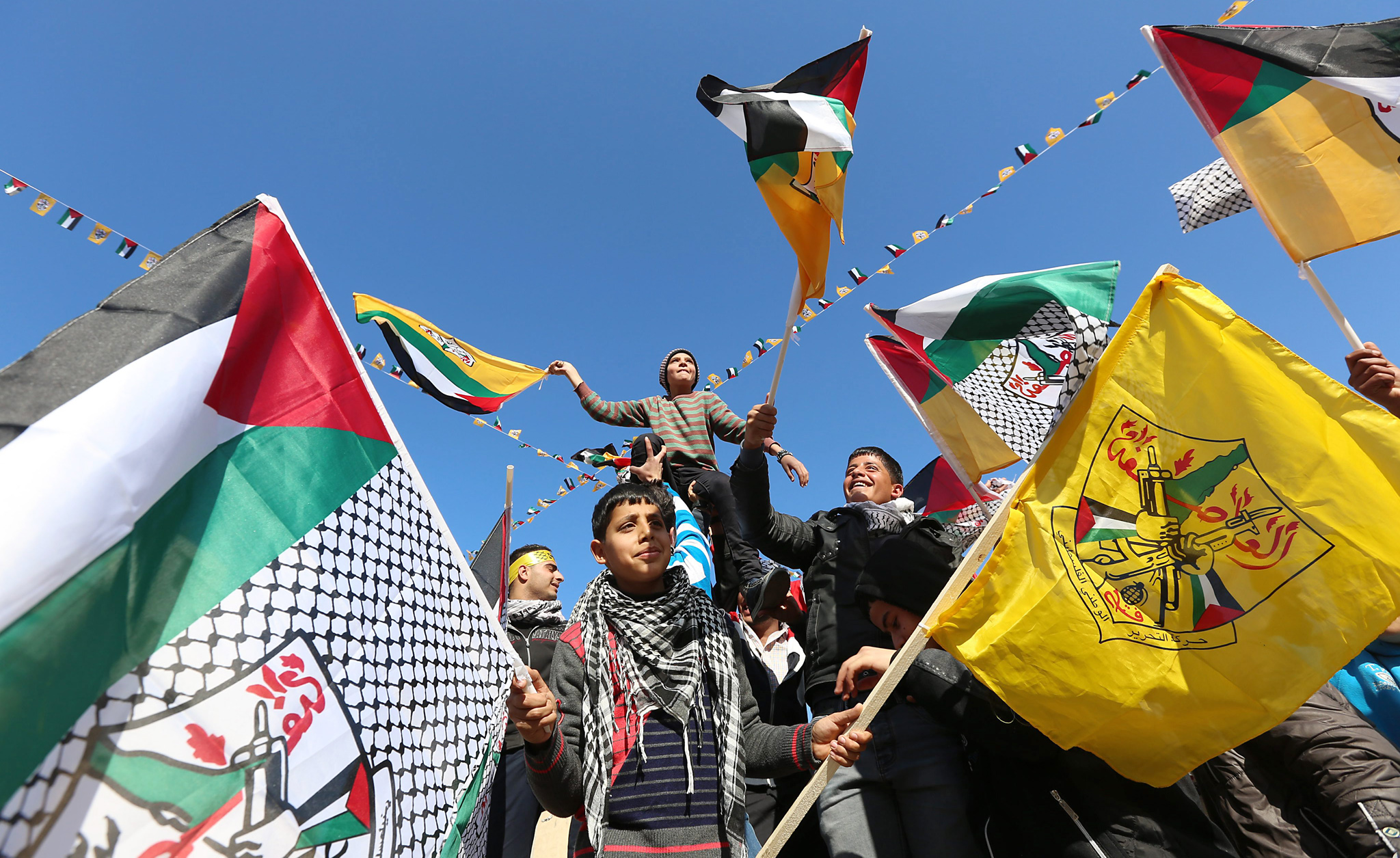 49th anniversary of the formation of the Fatah movement...epa04006024 Palestinians wave Palestinian flags during a rally to mark  the 49th anniversary of the formation of the Fatah movement in the West Bank City of  Nablus  , 02 January 2014.