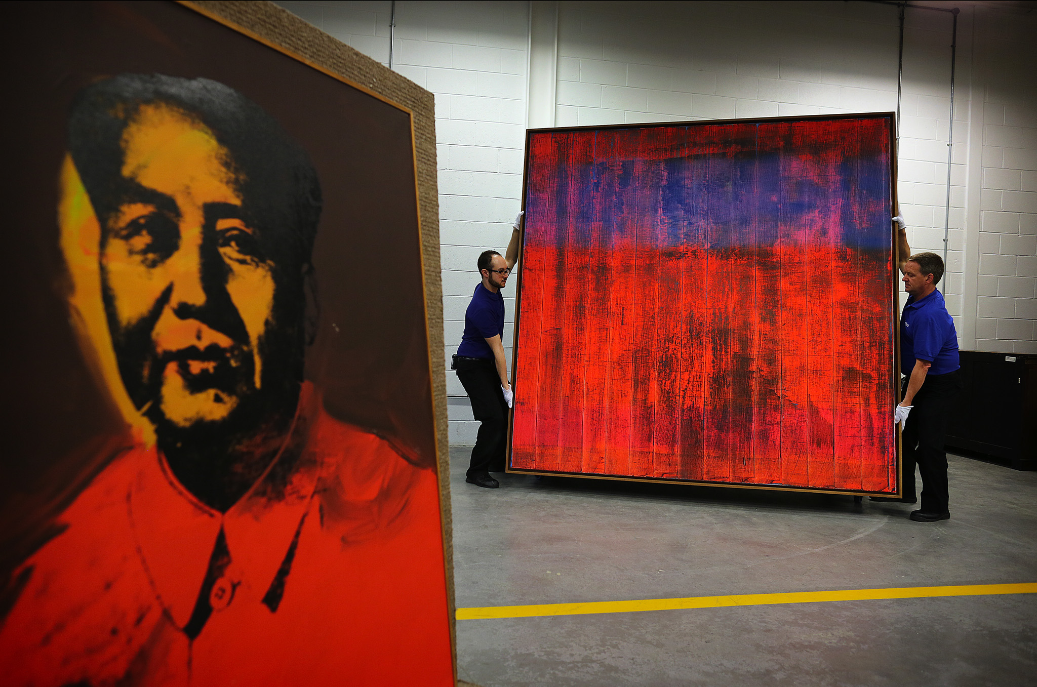 An Andy Warhol, Chairman Mao and a Red Gerhard Richter are unpacked in the Sothebys warehouse, West London.