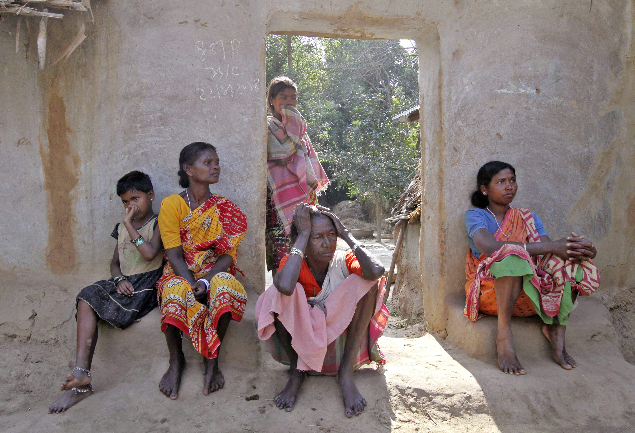 Villagers sit near the area where a woman was gang-raped at Birbhum district...Villagers sit near the area where a woman was gang-raped at Birbhum district in the eastern Indian state of West Bengal January 24, 2014. India's Supreme Court on Friday ordered an investigation into the gang rape of a 20-year-old woman from an eastern tribal region by 13 men on the orders of a village court, a case that has sparked protests demanding swift justice.