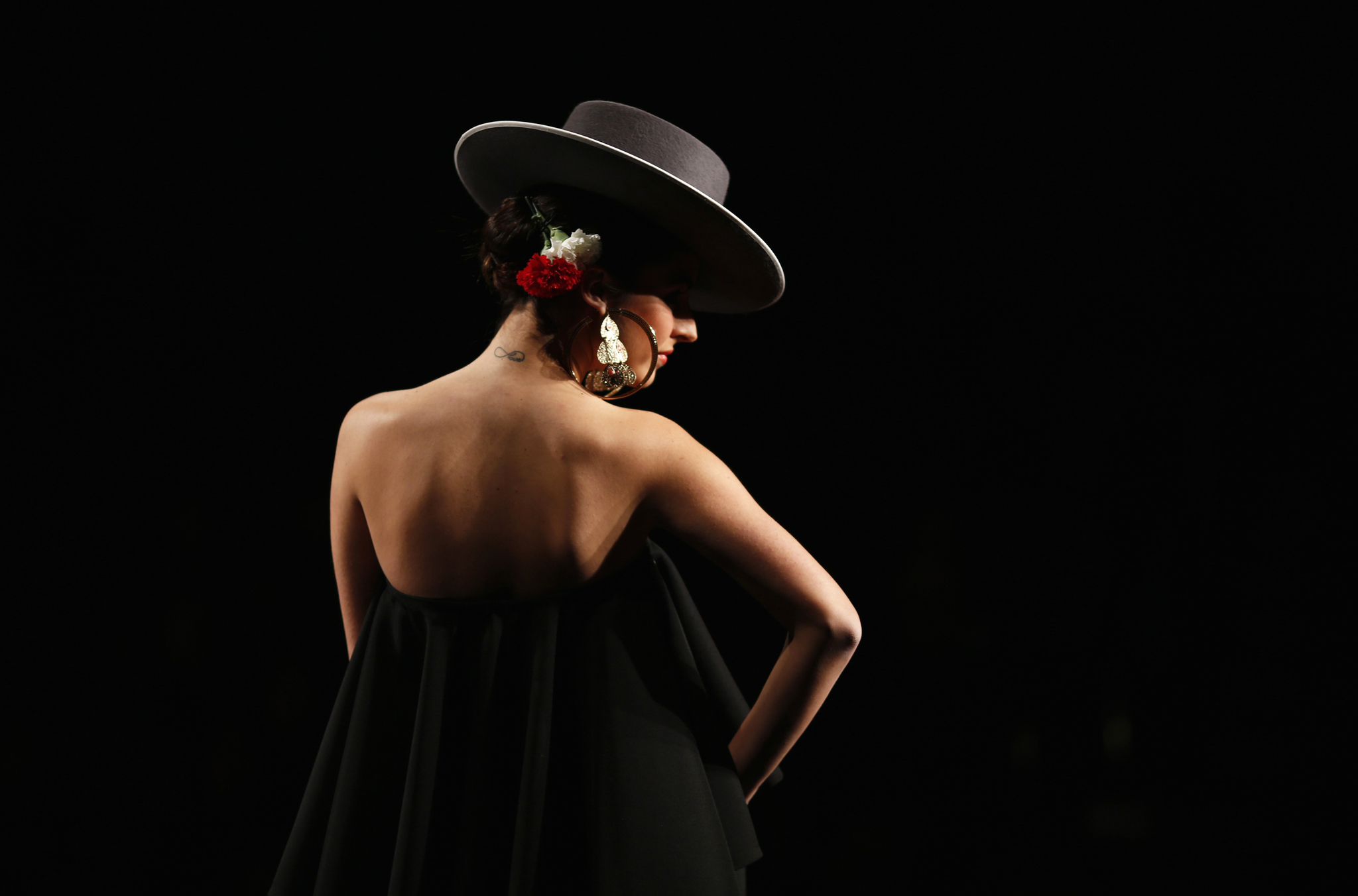 Model presents creation by Carmen G. Vazquez during the International Flamenco Fashion Show SIMOF in the Andalusian capital of Seville...A model presents a creation by Carmen G. Vazquez during the International Flamenco Fashion Show SIMOF in the Andalusian capital of Seville January 30, 2014. The show will run until February 2. REUTERS/Marcelo del Pozo