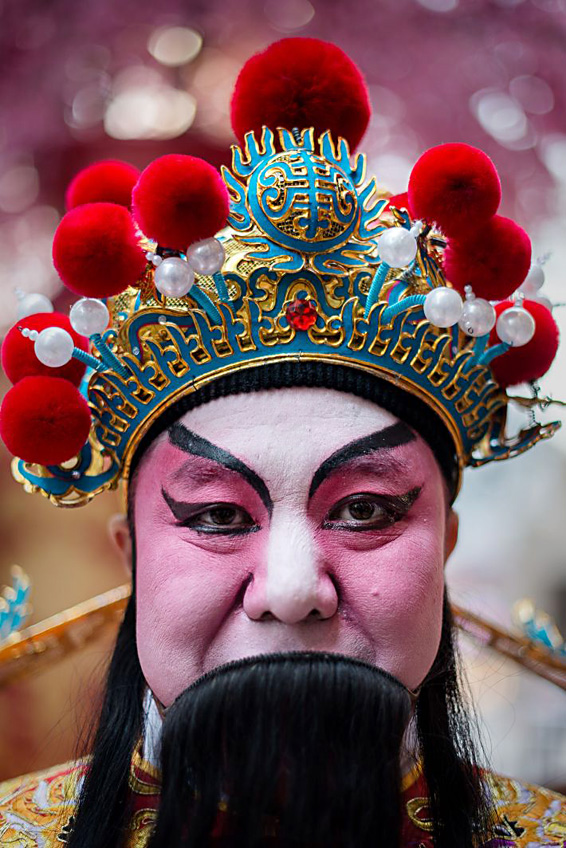 A performer wearing a traditional costum...A performer wearing a traditional costume looks on during an event organised by a shopping mall to celebrate the upcoming Chinese New Year of the horse in Hong Kong on January 23, 2014. The Lunar New Year falls on January 31 and marks the beginning of the year of the horse in China.  AFP PHOTO / Philippe LopezPHILIPPE LOPEZ/AFP/Getty Images