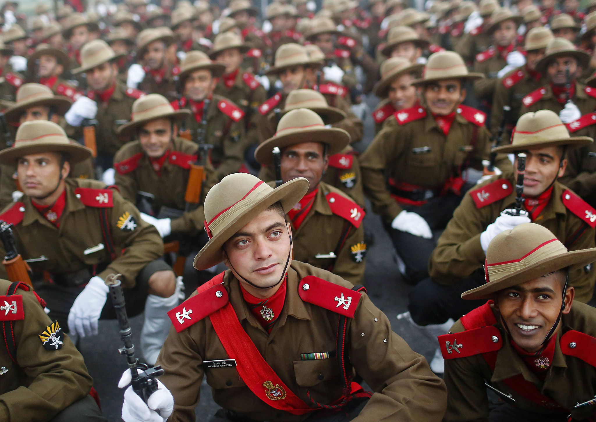 Indian soldiers rest after their rehearsal for the Republic Day parade on a cold winter morning in New Delhi...Indian soldiers rest after their rehearsal for the Republic Day parade on a cold winter morning in New Delhi January 2, 2014. India will celebrate its annual Republic Day on January 26. REUTERS/Anindito Mukherjee