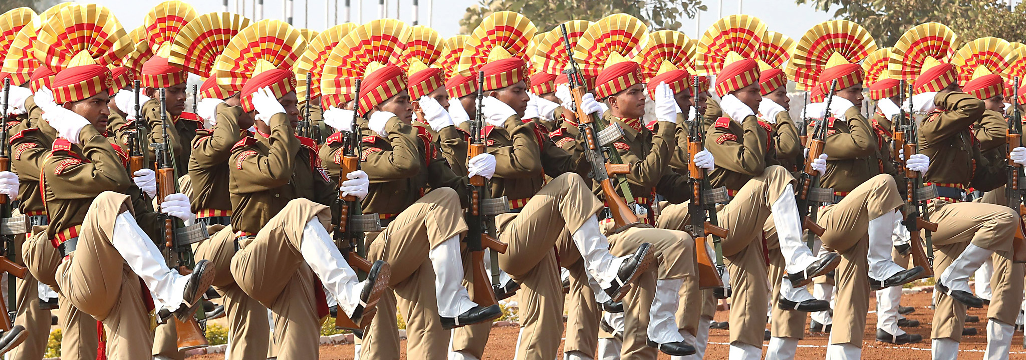India's Central Armed Police Forcesí Sashastra Seema Bal (SSB) contigents...epa04006827 India's Central Armed Police Forcesí Sashastra Seema Bal (SSB) contigent  performs during the passing out parade at their training headquarters near Bhopal, India on 03 January 2014. Around 415 cadets from all over the country took part in the convocation parad after completing a rigorous training programme. SSB is also celebrating its golden jubilee year of its foundation.  EPA/SANJEEV GUPTA