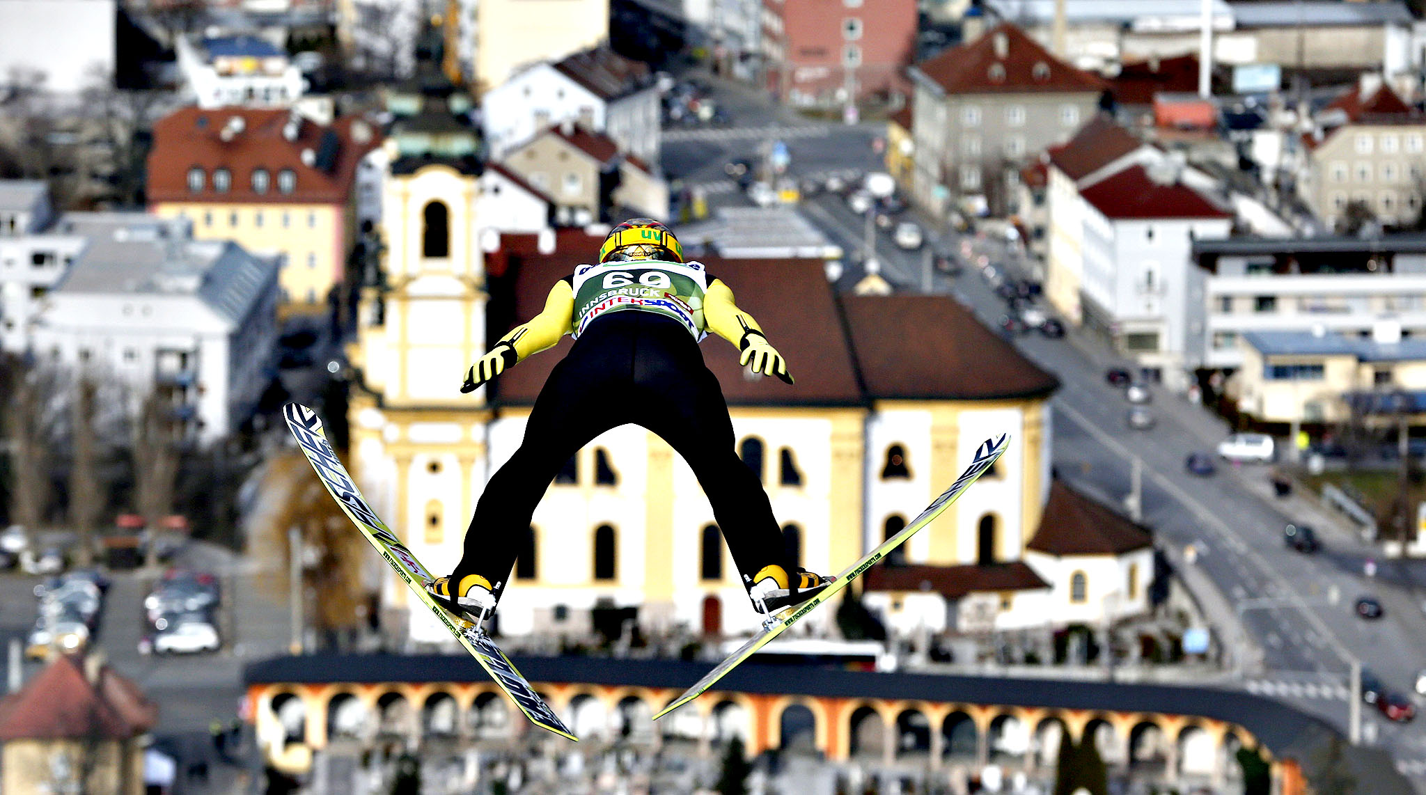 Japan's Noriaki Kasai soars in front of the Wilten Basilica during his trial jump at the third stage of the four hills ski jumping tournament in Innsbruck, Austria, Friday, Jan. 3, 2014.