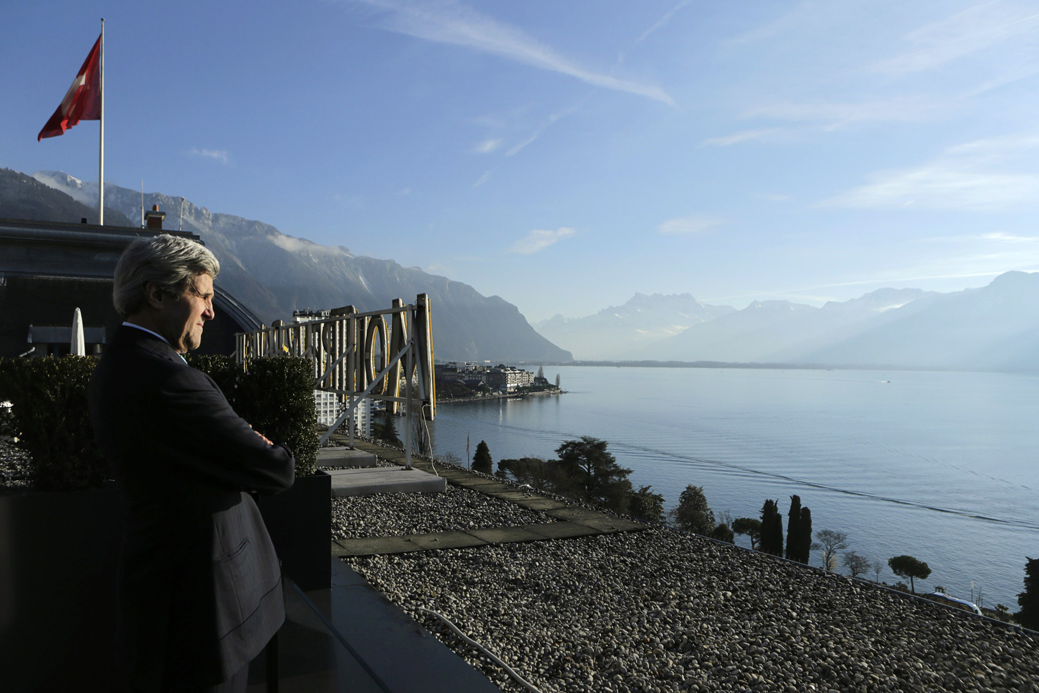 United States Secretary of State John Kerry looks out at Lake Geneva outside of his meeting room in Switzerland...United States Secretary of State John Kerry looks out at Lake Geneva outside of his meeting room in Montreux January 22, 2014.  Syria's government and its enemies come face to face on Wednesday for the first time as world powers try to set aside their own differences and push for an end to three years of civil war that is unsettling the entire Middle East.     REUTERS/Gary Cameron