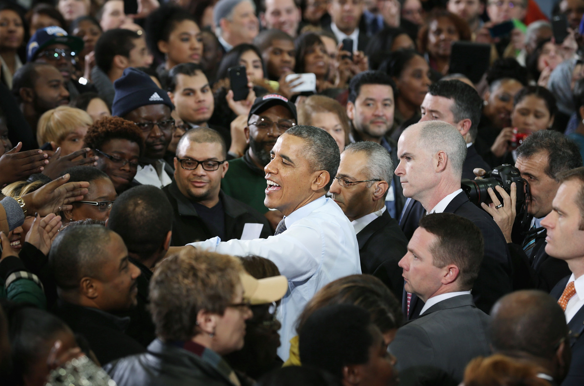 President Obama Delivers Economic Address At A Maryland Costco...LANHAM, MD - JANUARY 29:  U.S. President Barack Obama greets supporters, local politicans and store employees after delivering remarks at Costco January 29, 2014 in Lanham, Maryland. Repeating some of the same policy proposals from his State of the Union speech the night before, Obama is beginning a two-day, four-state tour to promote a raise in the minimum wage, immigraiton reform and other other policy ideas.  (Photo by Chip Somodevilla/Getty Images)
